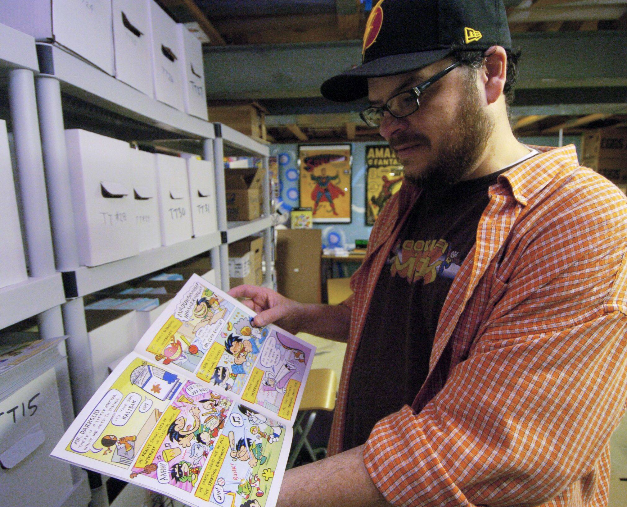 "Comic book artist Art Baltazar of Streamwood with a copy of ""Tiny Titans."""
