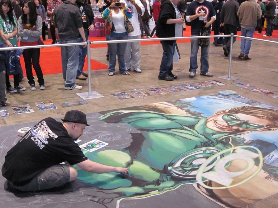 Artist Eric Maruscak uses chalk to create his own version of a popular Green Lantern cover on the floor of C2E2.