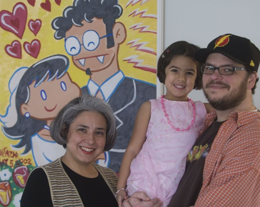 Art Baltazar at his home with wife, Rose, and daughter Audrey.