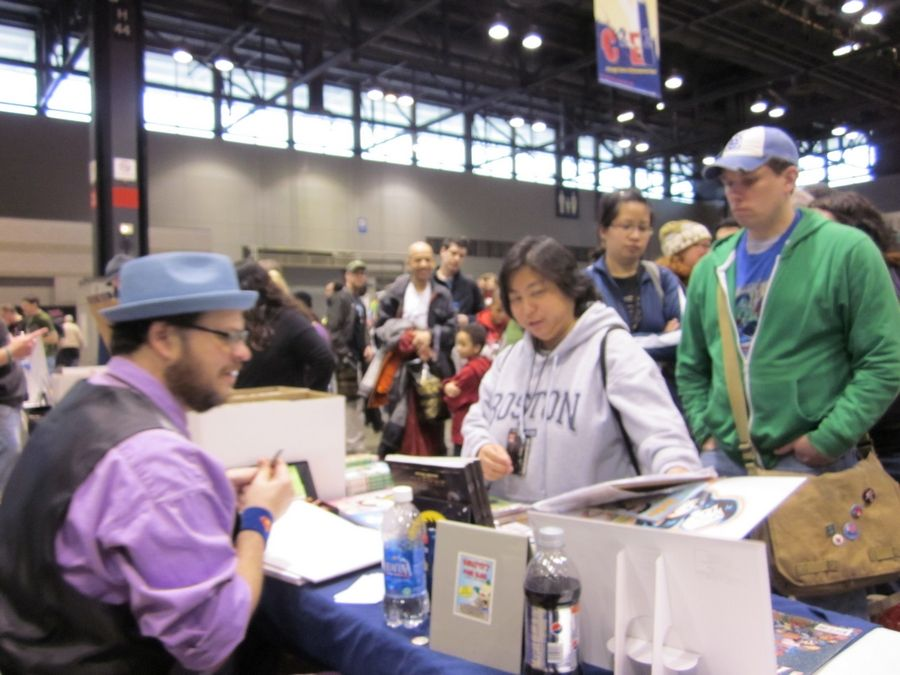Art Baltazar draws a sketch for fan Angela Wong, from San Jose, Calif. at C2E2.