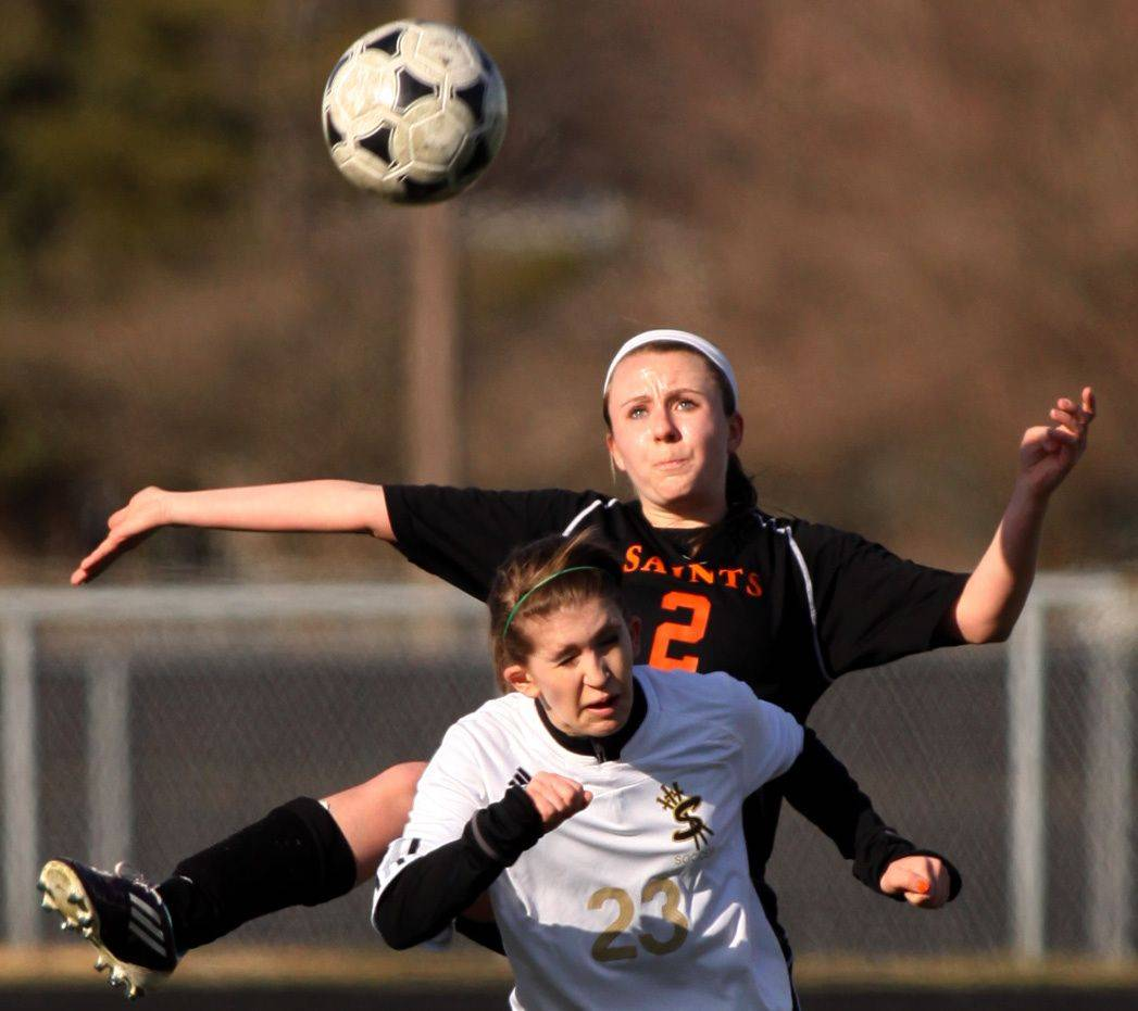 Streamwood's Brianna Spike, front, and St. Charles East's Christina Reuth battle for the ball Thursday .