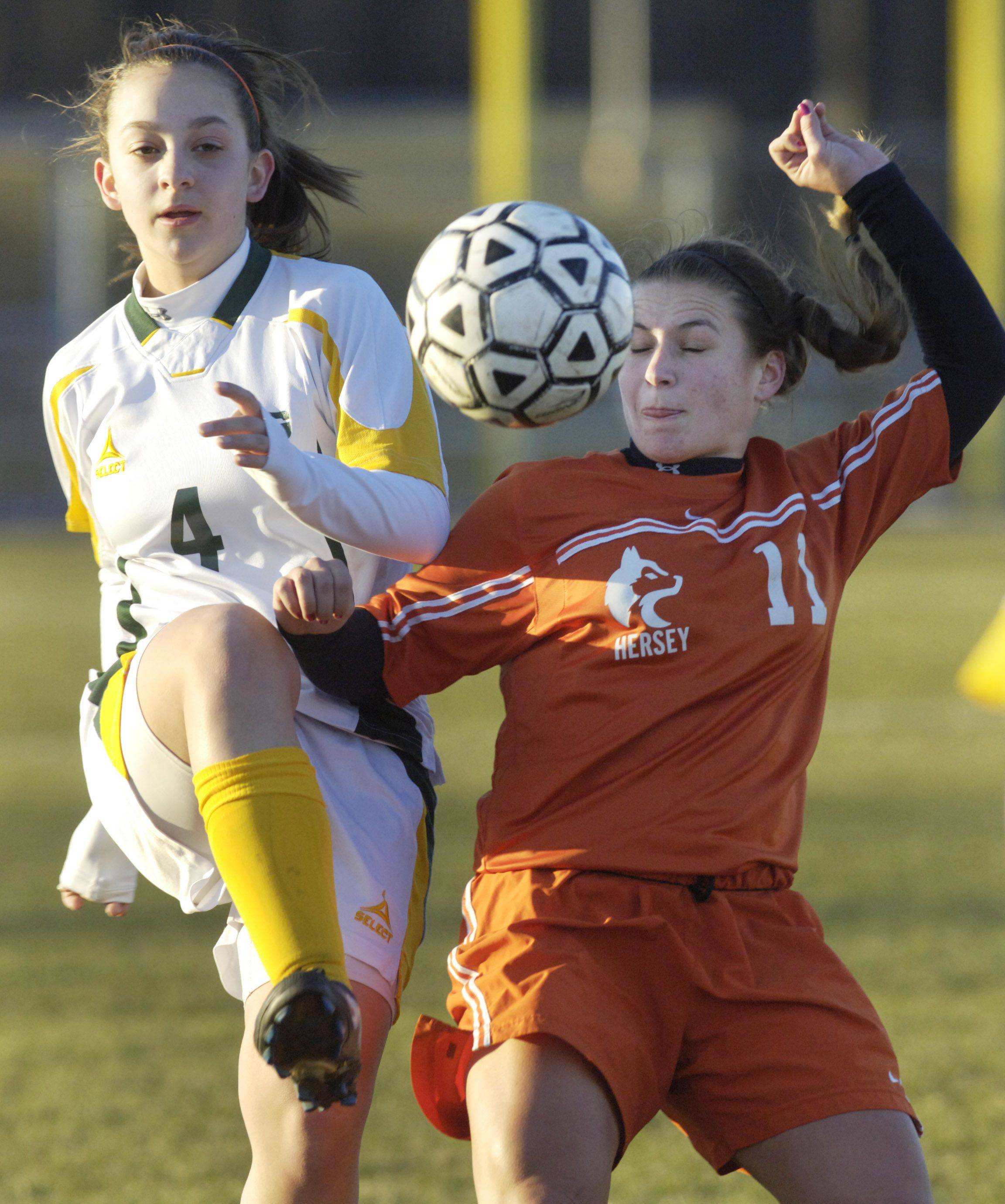 Elk Grove's Sarah Stram, left, kicks the ball past Hersey's Nicole Pietro during Wednesday's game.