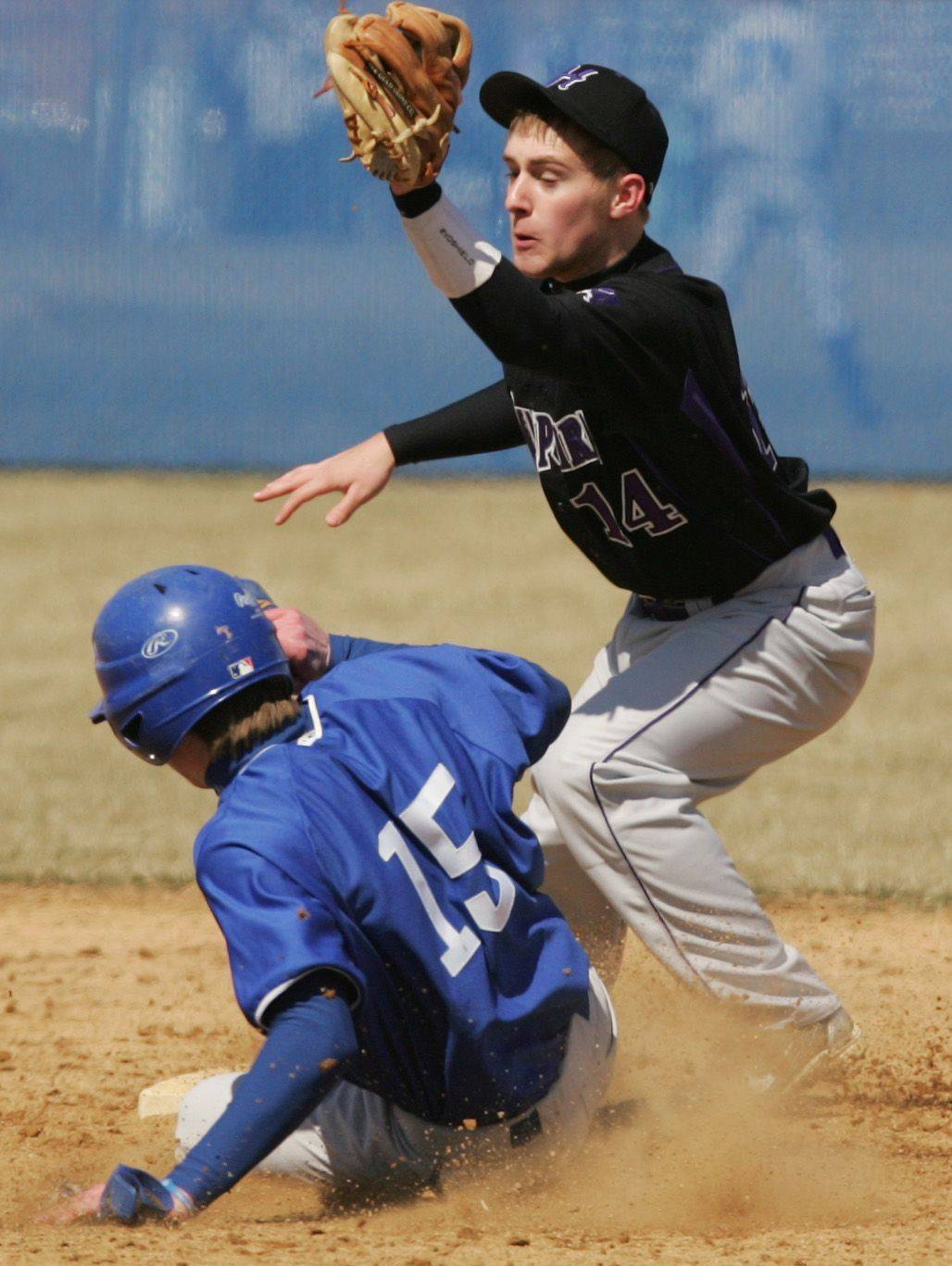 Hampshire's Zack Skog prepares to make a tag on Larkin baserunner Trevor Whitehead but can't make the play Monday.