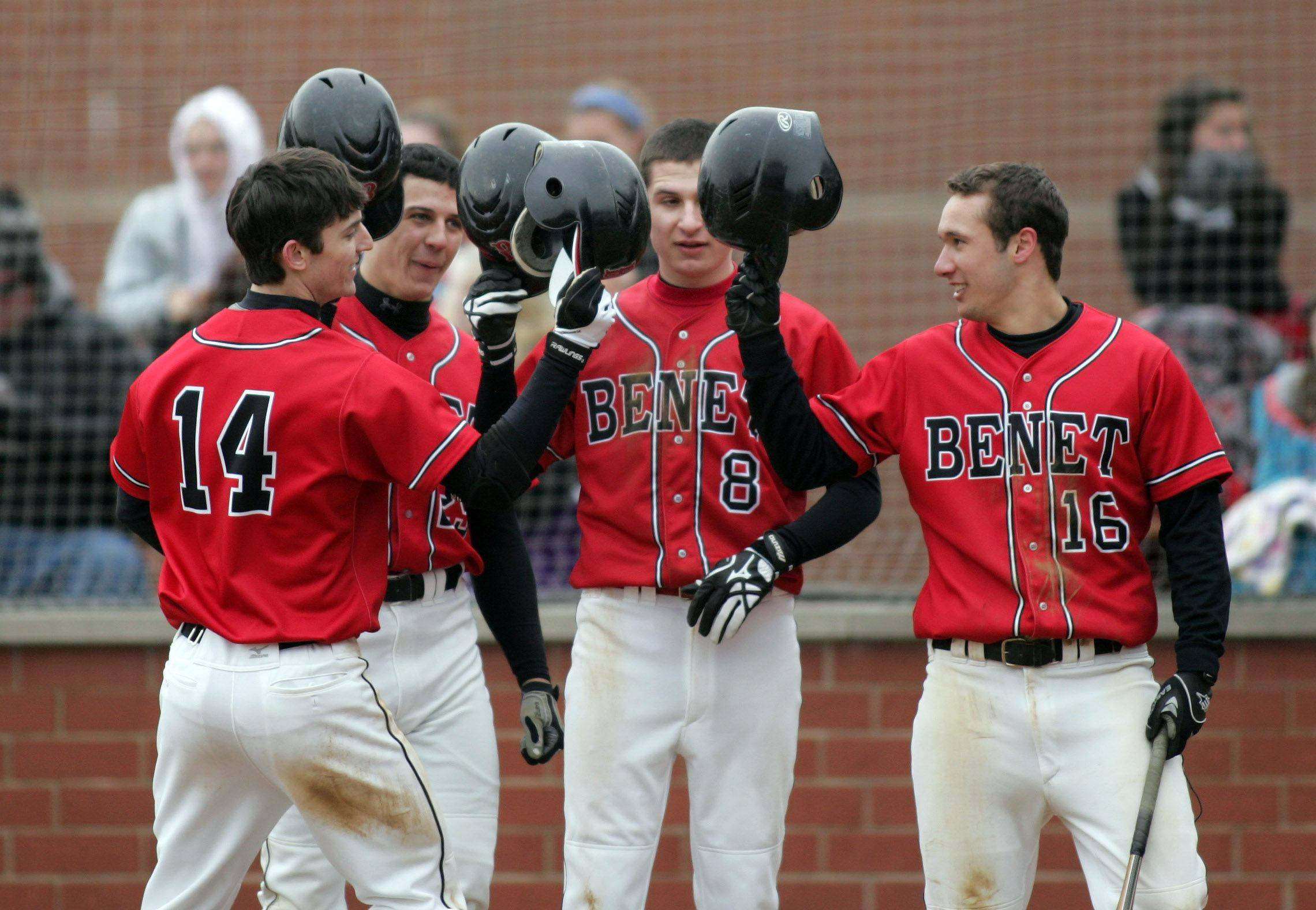 R. J. Gatto of Benet is greeted by teammates in the third inning after hitting a home run against Downers Grove North Tuesday in Lisle.