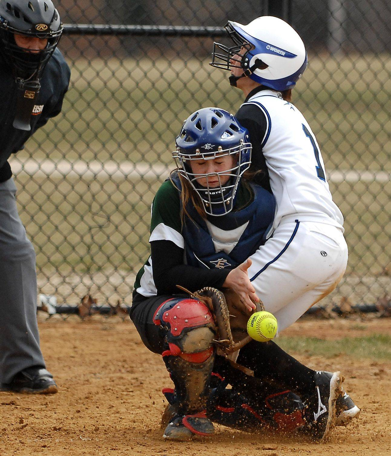 St. Charles North's Loren Cihlar collides with Plainfield Central catcher Carly Baker during Tuesday's game in St. Charles. Cihlar scored on the play.