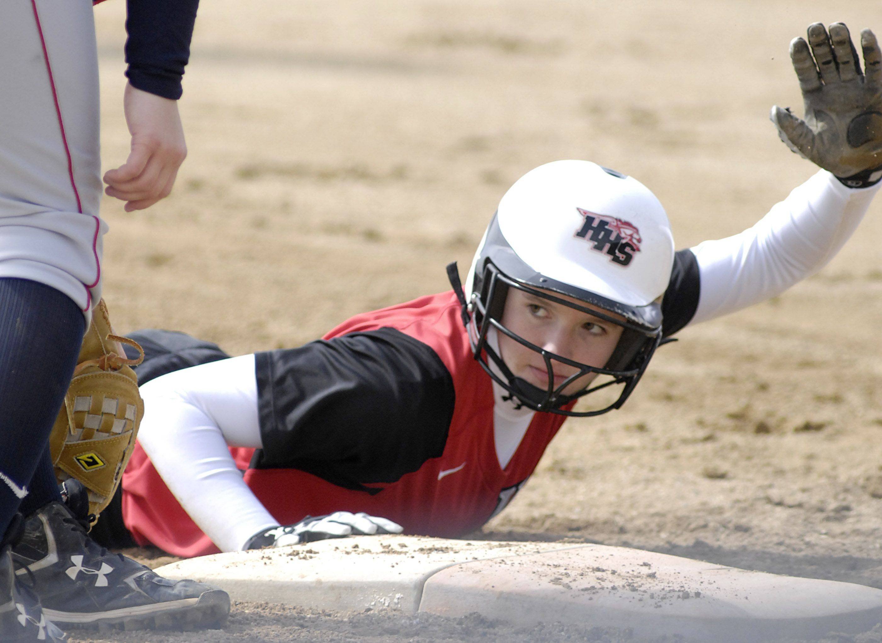 Huntley's Randi Peterson slides back to first in the third inning on Tuesday against South Elgin.
