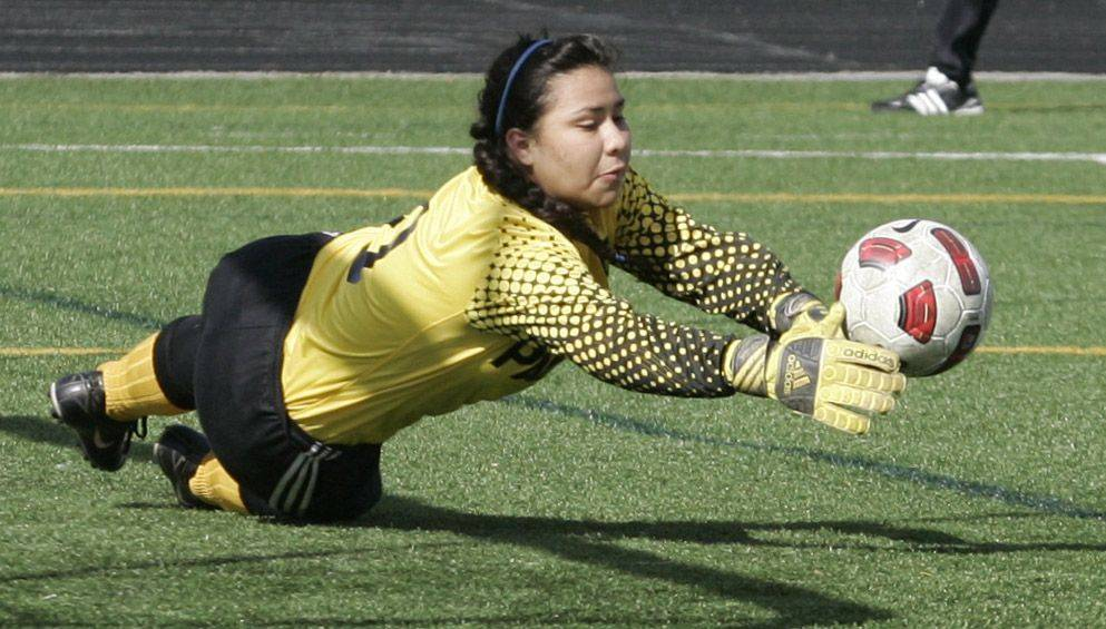 Round Lake goalie Cristobel Carrera makes a save Tuesday against Grant.