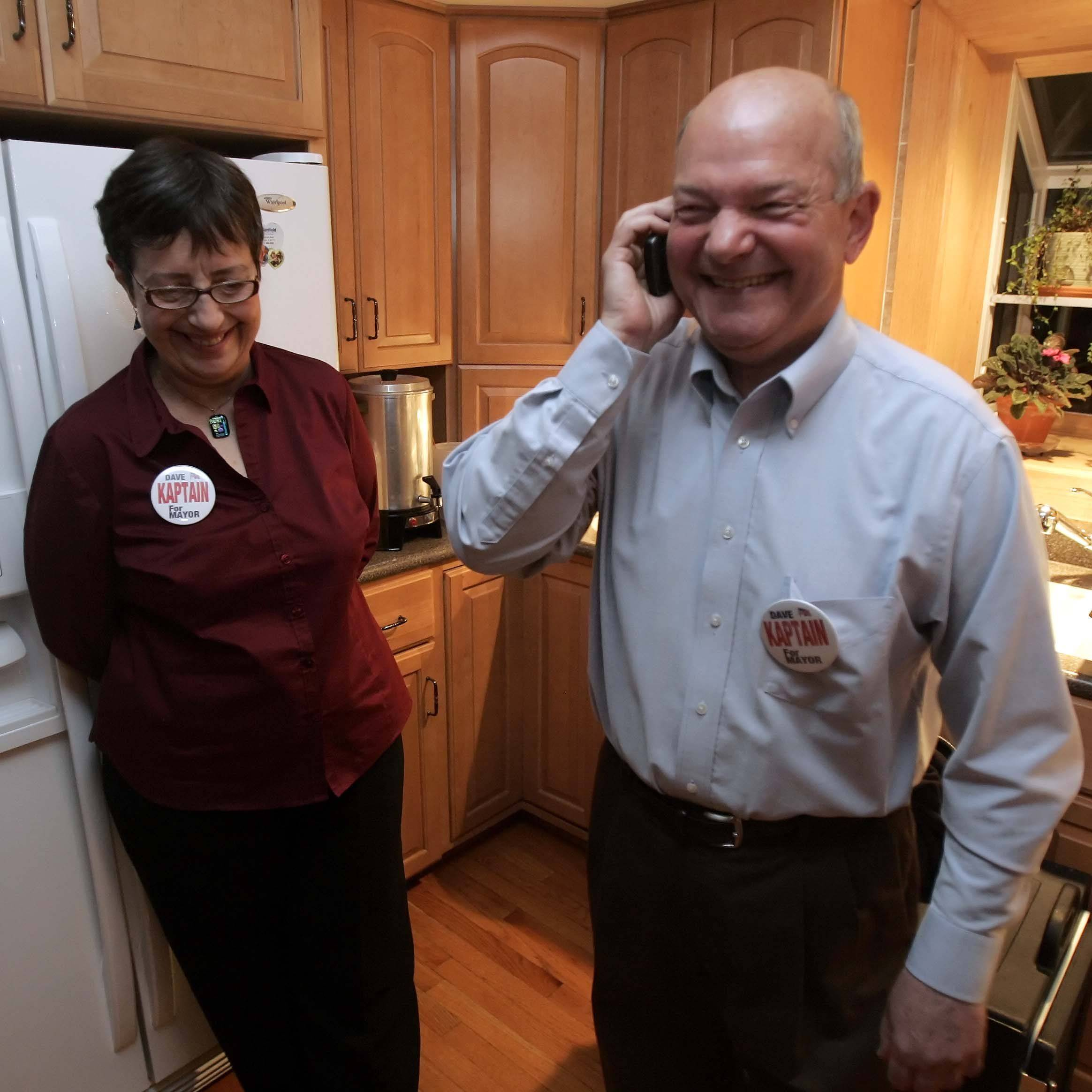 Elgin Councilman David Kaptain and his wife, Sandy, react as election results roll in at Kaptain neighbor's house. Kaptain unseated 12-year Mayor Ed Schock