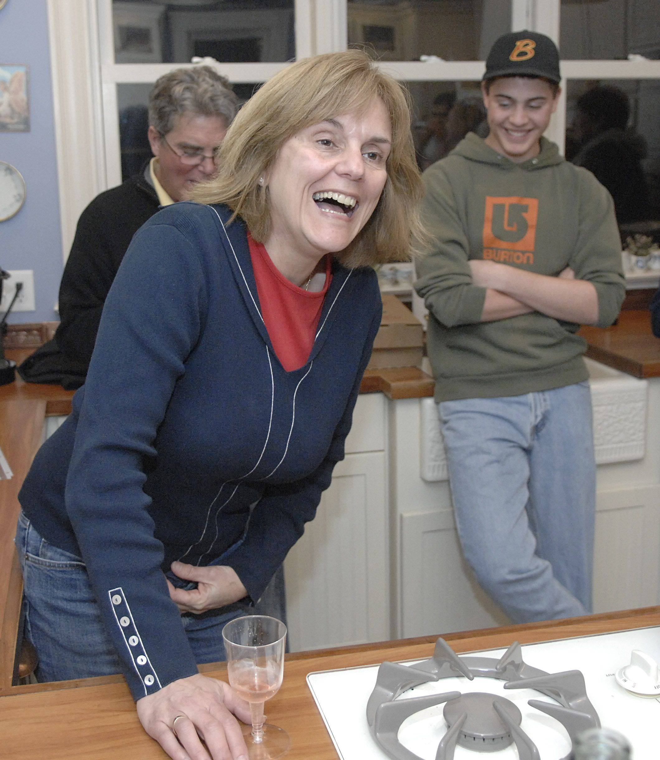 Batavia 4th Ward alderman candidate Susan Stark jokes with family and friends in her Batavia home as election results come in Tuesday night. Her husband Vincent Gatto and son Jonathan Seagren are in back.