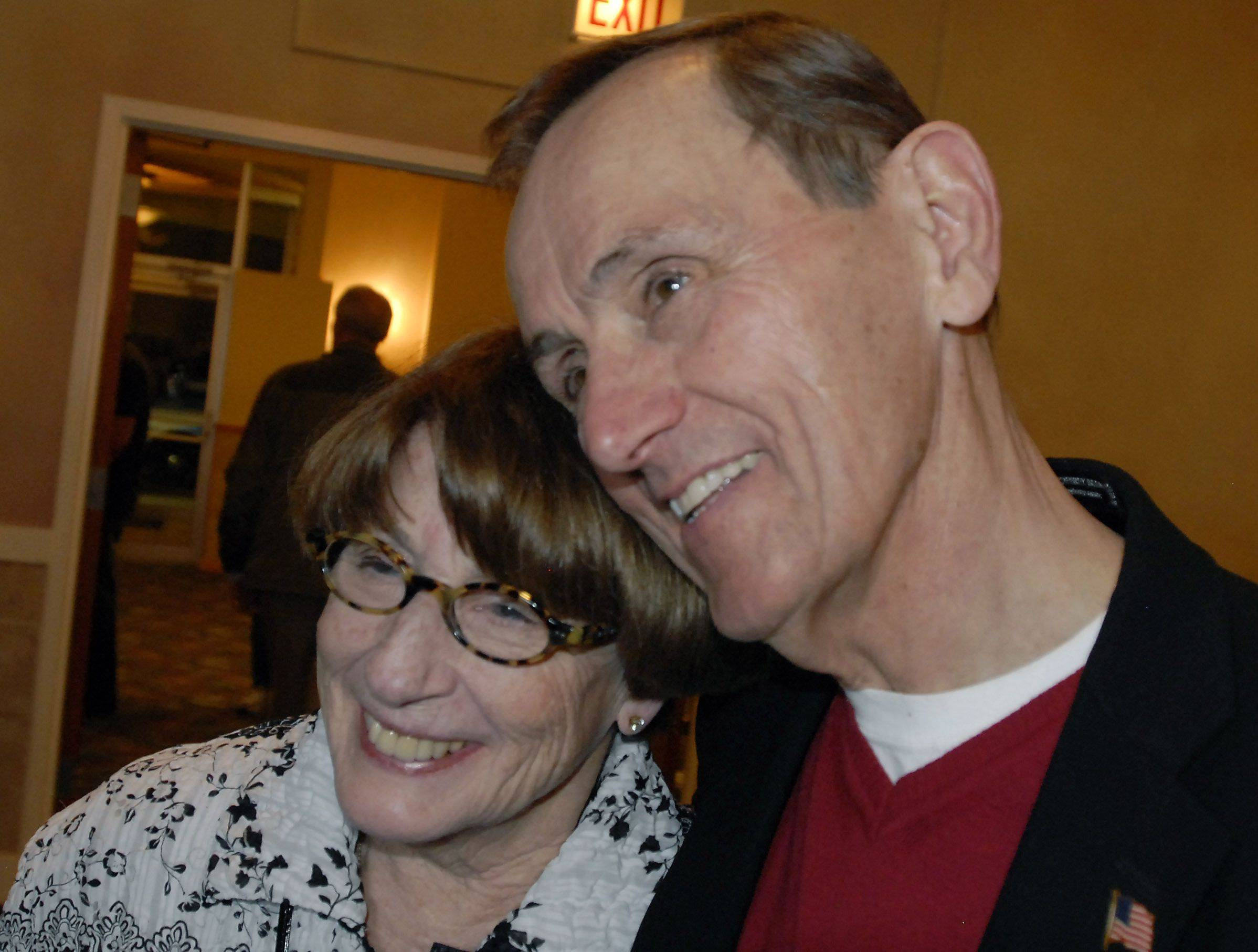 "Nicholas ""Nick"" Helmer gets a hug from Gail Helmer, his wife of 46 years, at his victory party tonight."