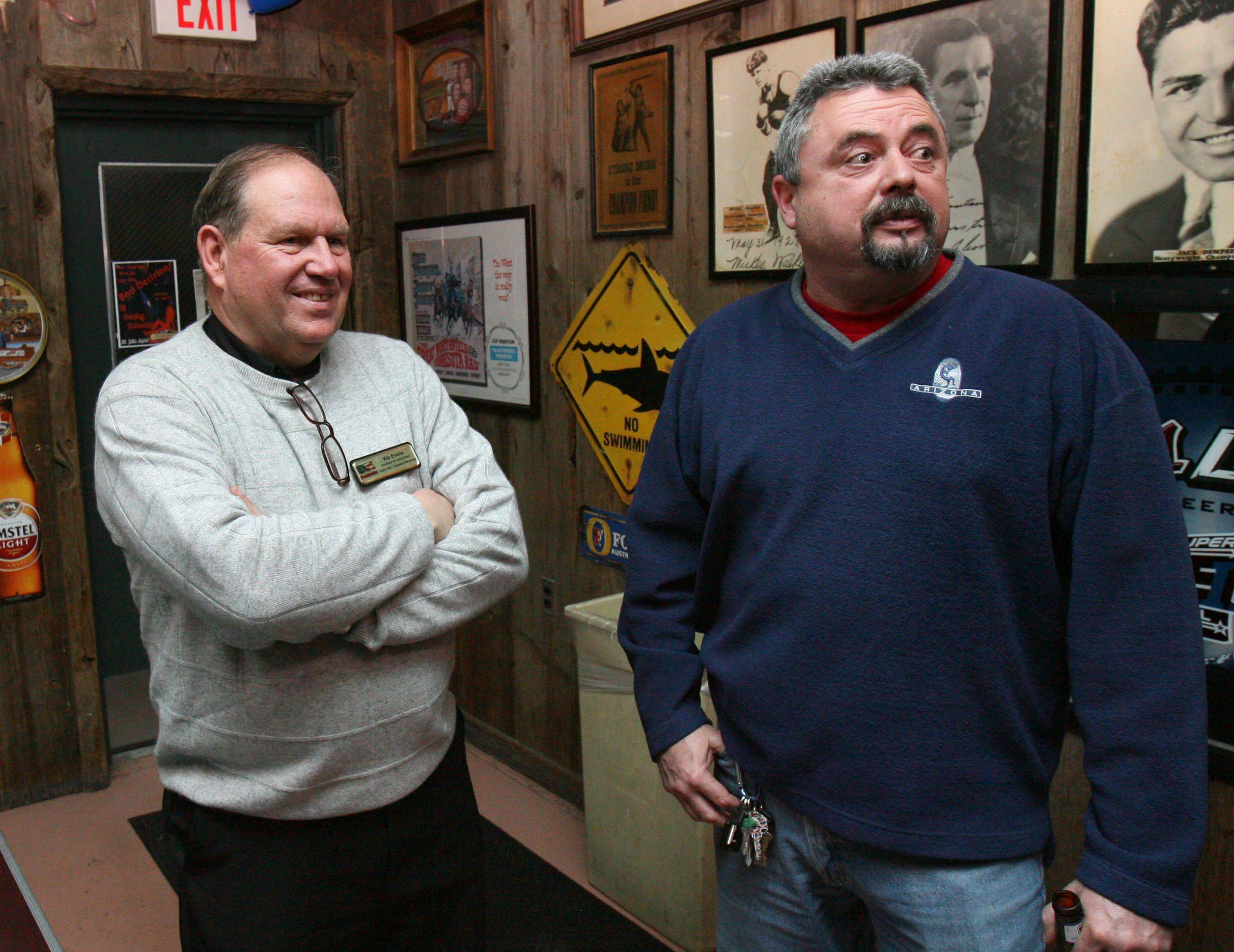 Newly elected Grayslake District 46 school board member Kip Evans, left, talks with Avon Township Highway Commissioner Tom Brust Tuesday night at Last Chance Saloon in Grayslake.
