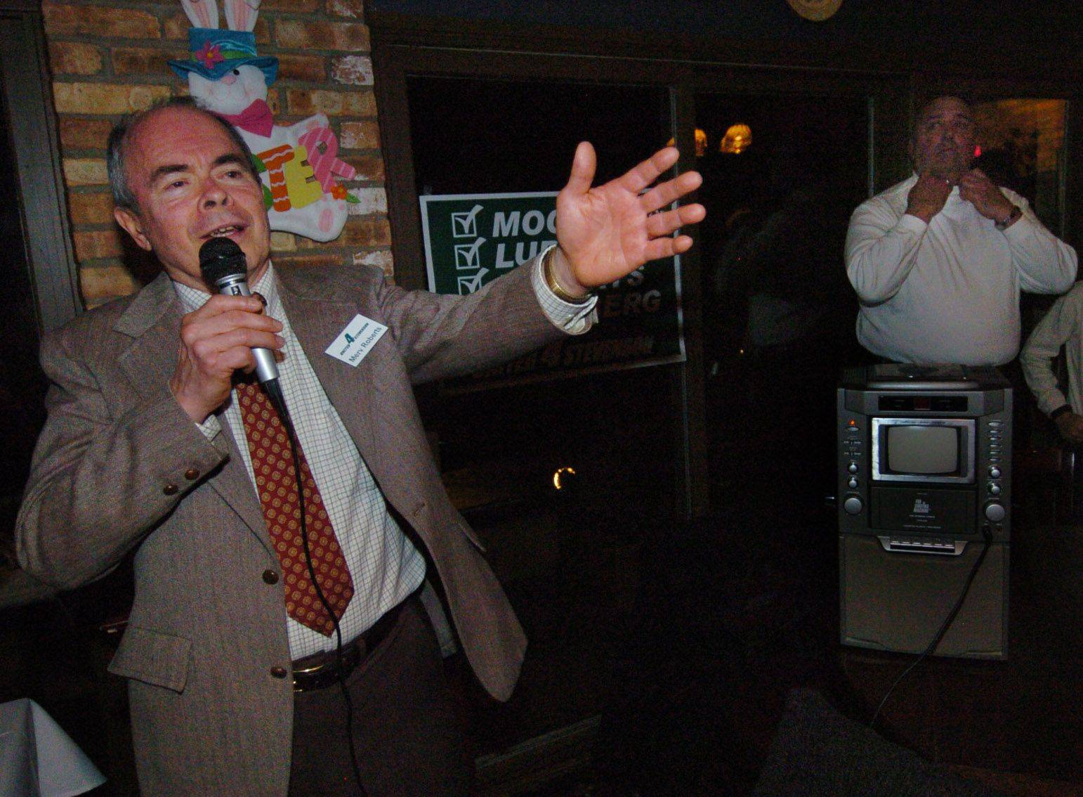 Merv Roberts gives a victory speech during Stevenson High School District 125 victory party.