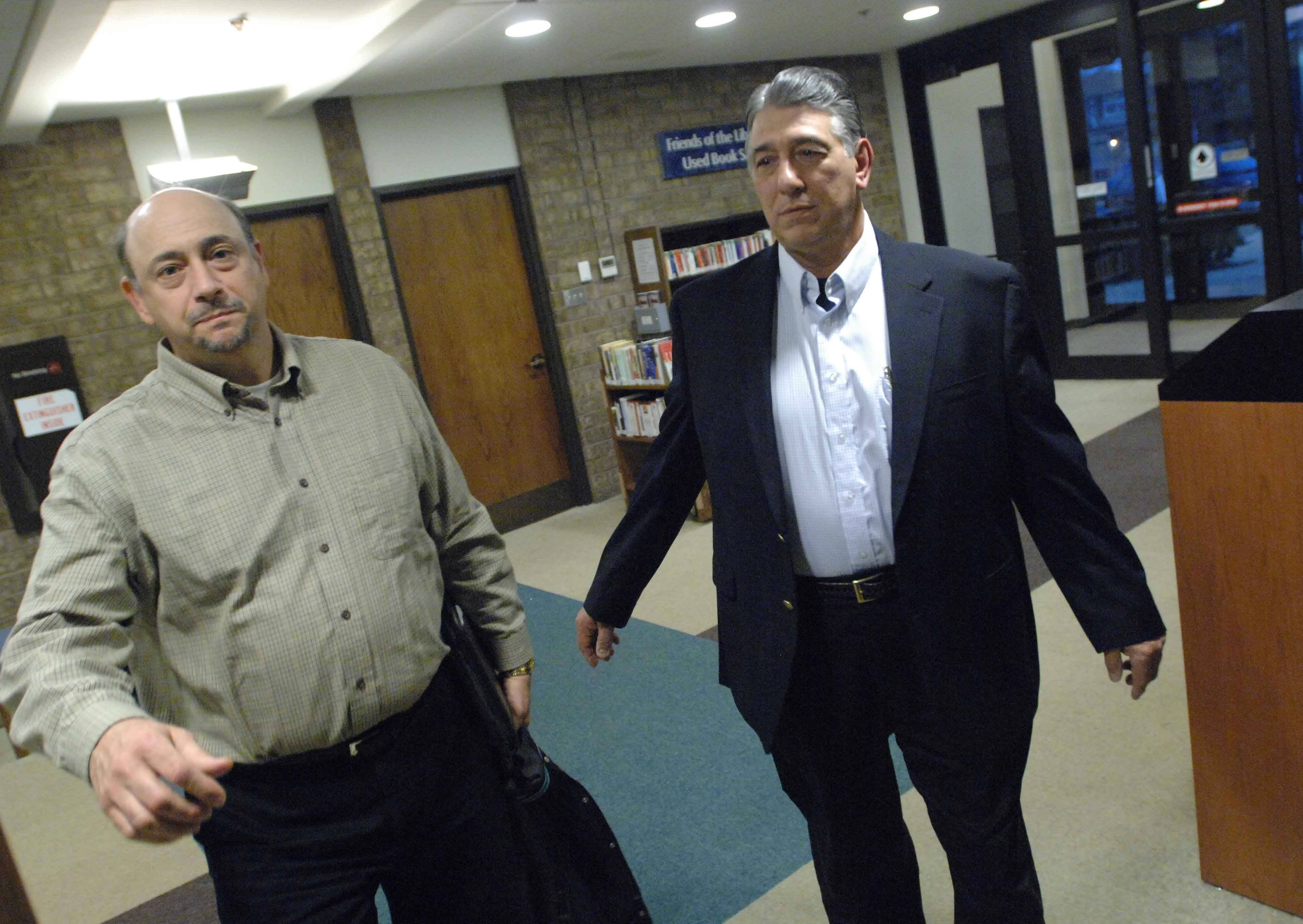 PAUL MICHNA/Pmichna@dailyherald.comDavid DeRango,left, and Dominick Jeffrey enter the Carol Stream Library's human resources meeting Wednesday.