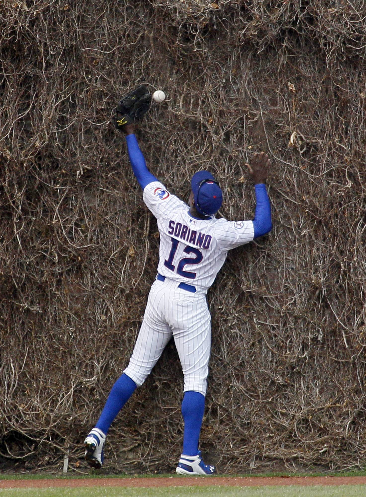 Cubs left fielder Alfonso Soriano is unable to catch a fly ball by Arizona Diamondbacks' Chris Young, allowing Willie Bloomquist to score from first, during the fifth inning Wednesday.