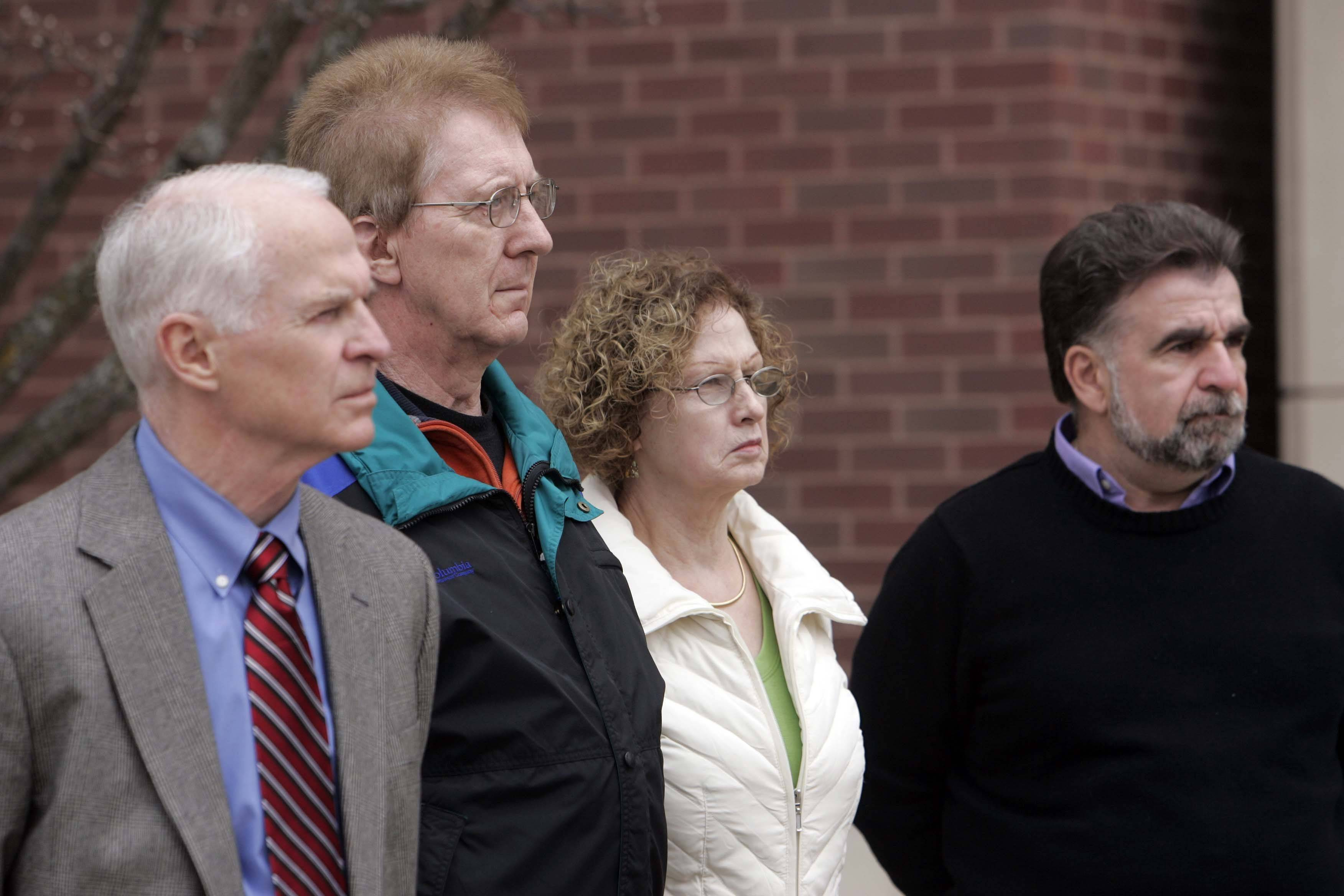 Supporters Bob Borchert, left, John Reckamp, Ria Reckamp and Tony Scimeca were among supporters of McHenry County State's Attorney Lou Bianchi who filed suit Thursday asking a judge to dismiss the special prosecutors who investigated Bianchi on corruption charges for incompetence and over billing.