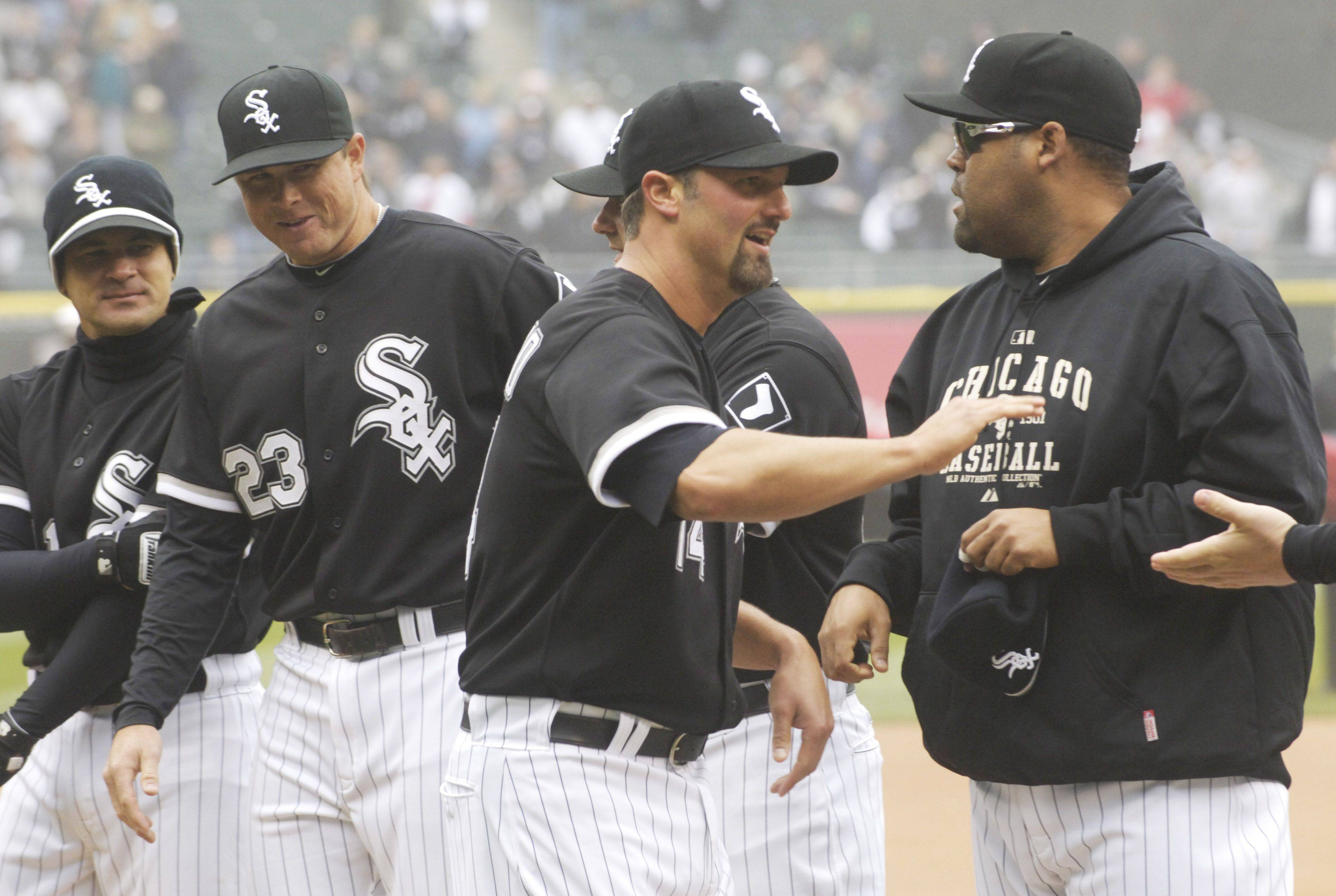 Paul Konerko is greeted on the field by teammates during player introductions at U.S. Cellular Field on Thursday.