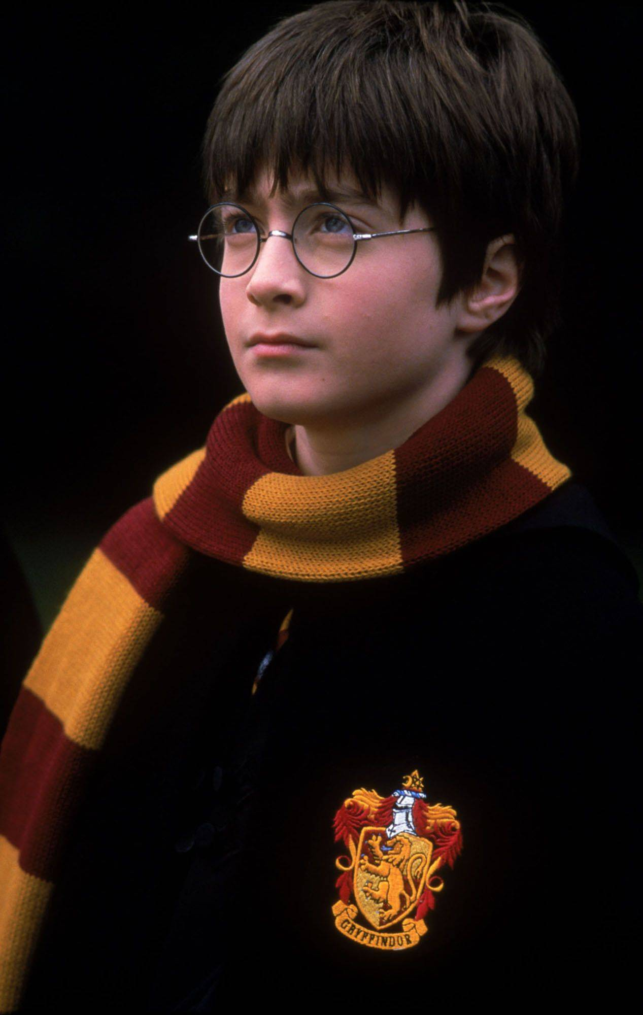 "Daniel Radcliffe, who plays the part of Harry Potter, is shown in this undated handout photo from a scene in Warner Bros. Pictures ""Harry Potter and the Sorcerers Stone."" Makers of the Harry Potter film called in a voice double after Radcliffe's voice broke during filming, a British newspaper reported Thursday, Nov. 1, 2001. The Sun said London schoolboy Joe Sowerbutts was hired to dub two scenes for 12-year-old star."