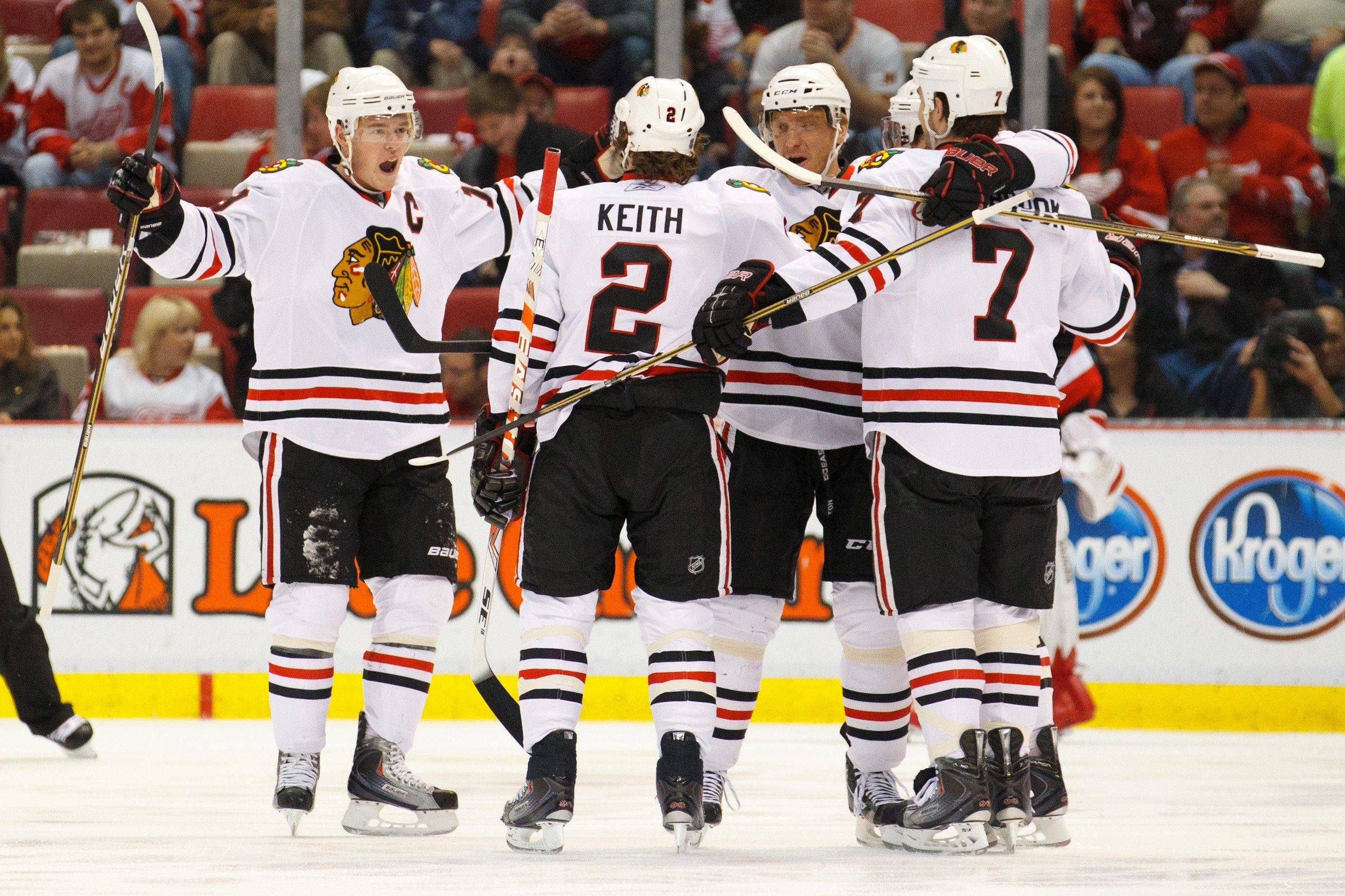 The Blackhawks celebrate a goal by defenseman Brent Seabrook (7) just 27 seconds into Friday night's victory at Detroit.