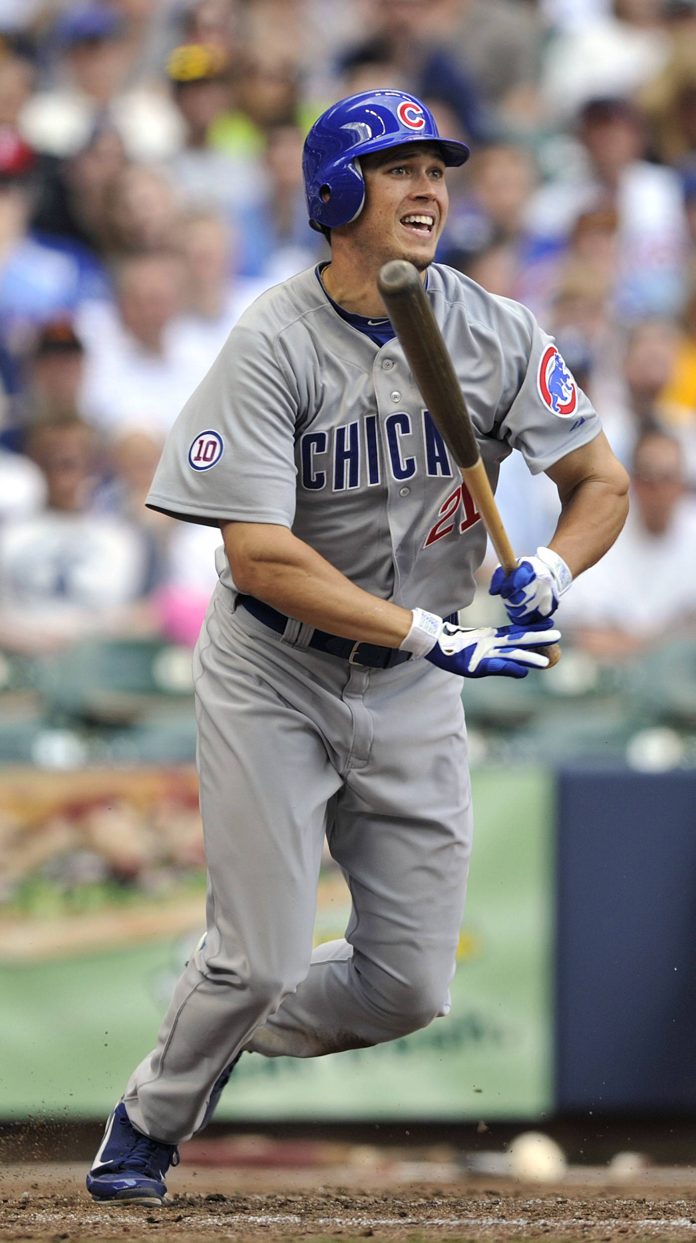 Chicago Cubs' Tyler Colvin drives in a run with a groundout against the Milwaukee Brewers during the seventh inning in Milwaukee Sunday.