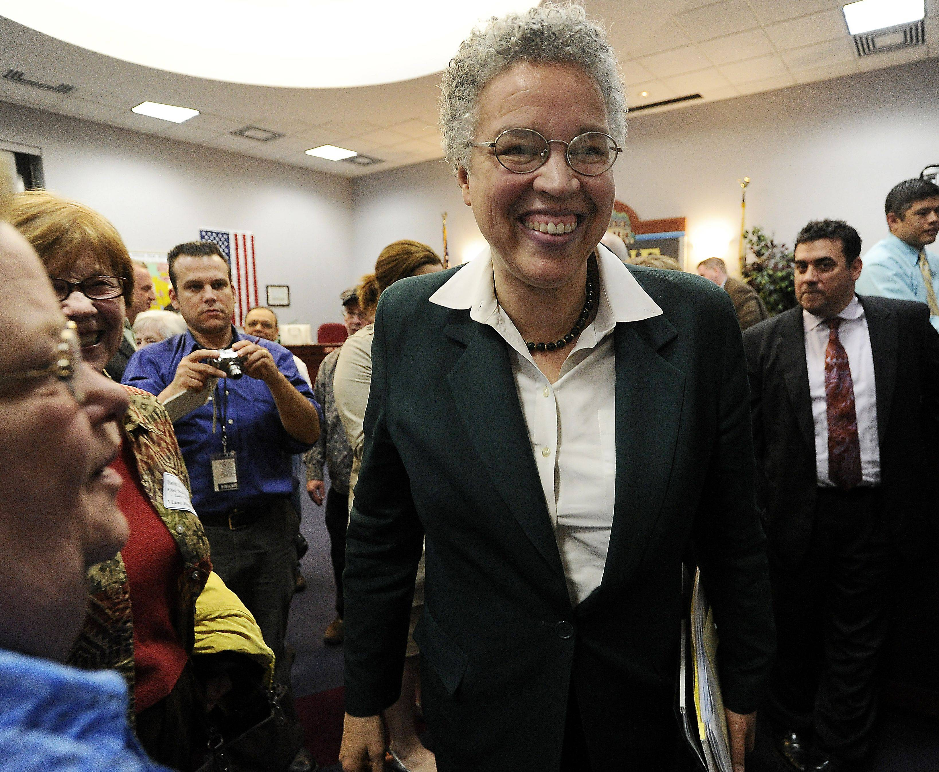 Cook County Board President Toni Preckwinkle got a warm reception from a standing-room-only crowd Monday when she appeared before the Palatine village council.