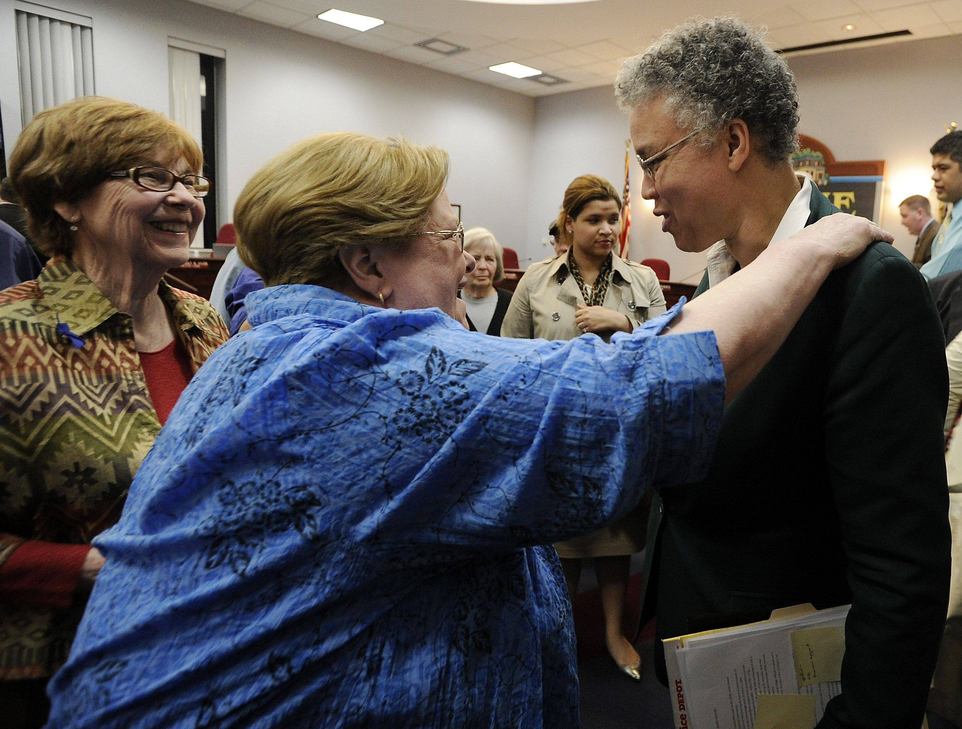 Cook County Board President Toni Preckwinkle got a warm reception from a standing-room-only crowd Monday when she appeared before the Palatine village council and Mayor Jim Schwantz to discuss county services.