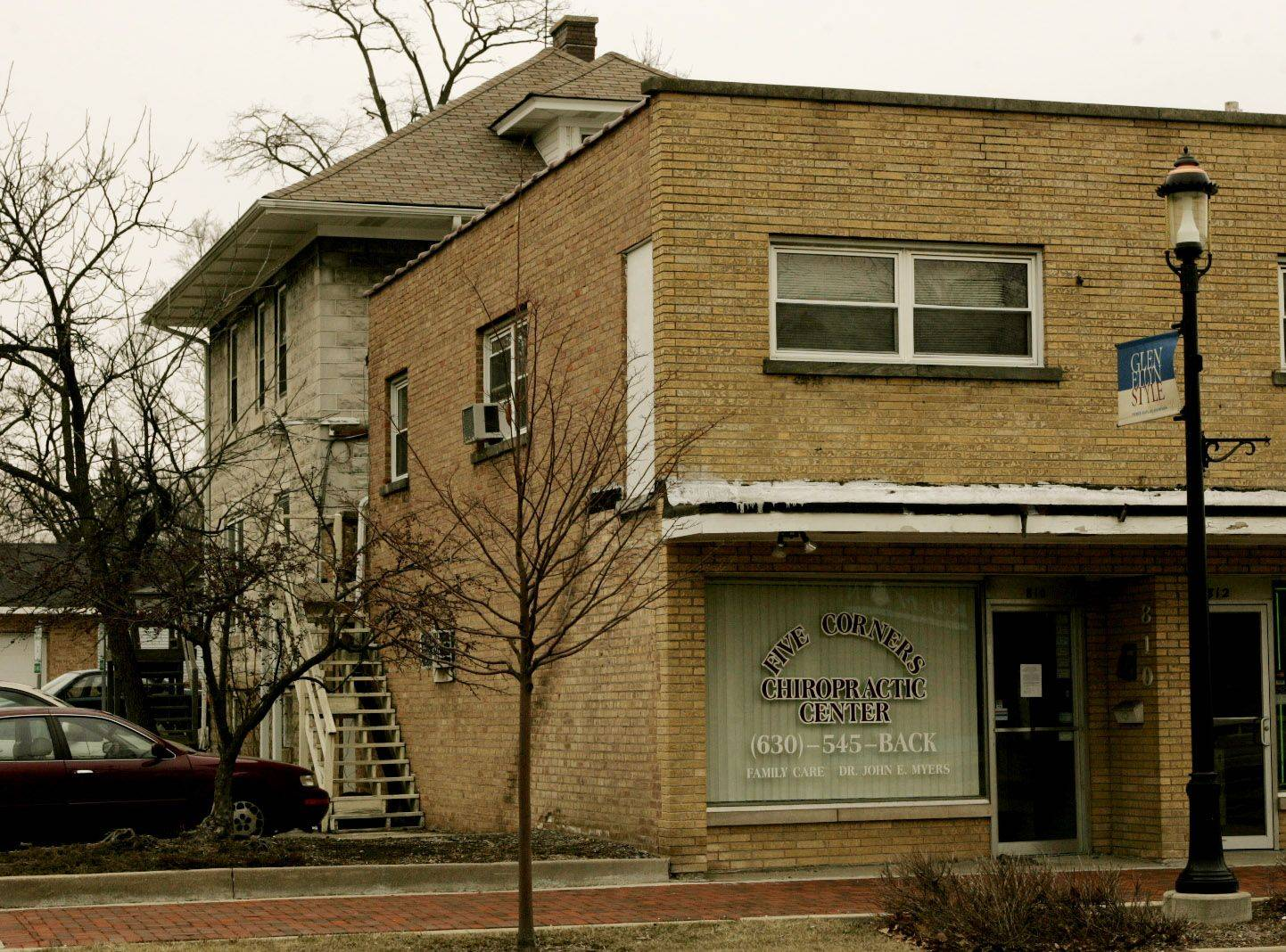 A task force report to the village of Glen Ellyn recommends a house at the back of the property at 810 N. Main St. be demolished, while the attached storefront commercial space be kept.