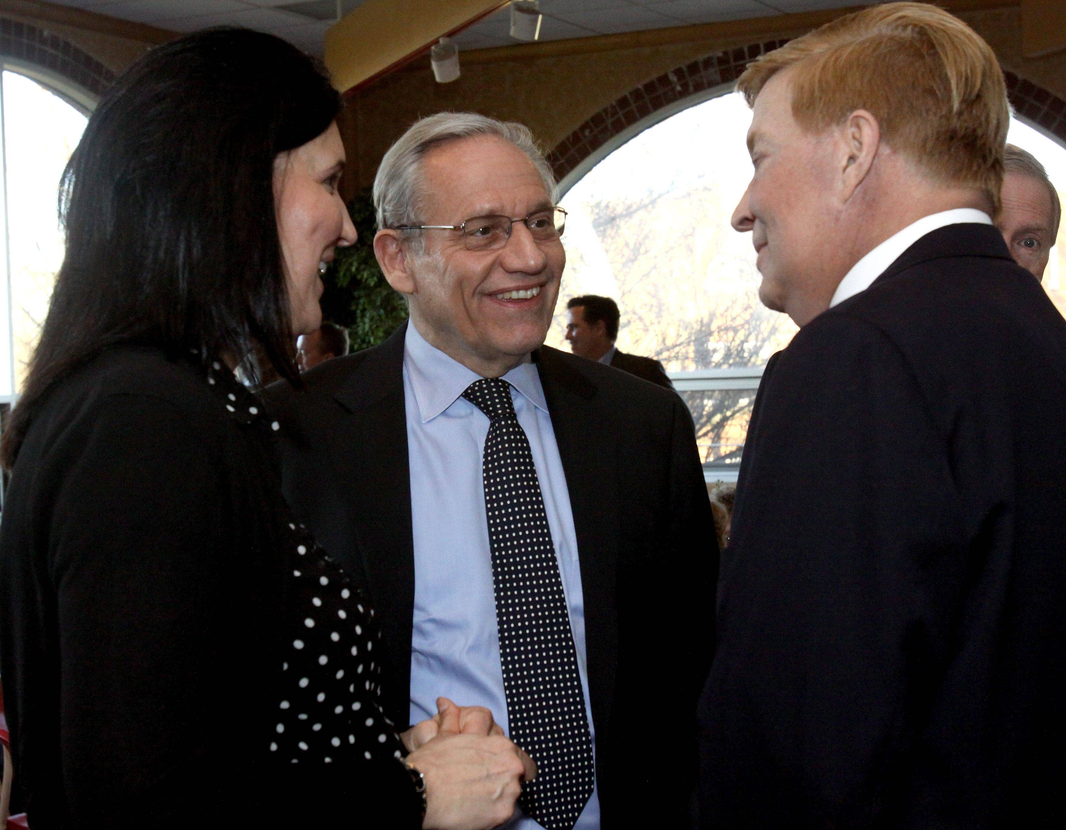 Bob Woodward, center, chats with Robert W. Fioretti, right, 2nd ward alderman in Chicago, and his friend Nicki Pecori, left, before giving a talk Tuesday at Benedictine University in Lisle.
