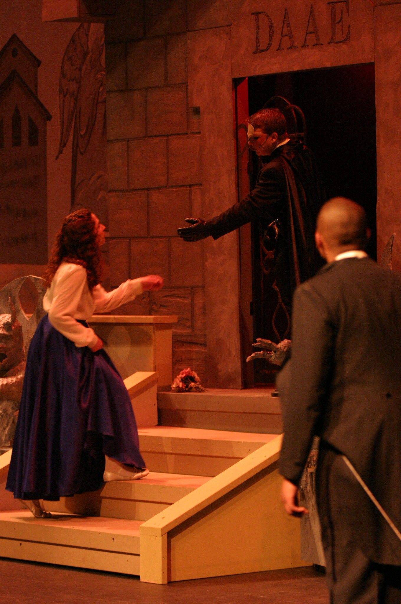 "Brandon Pisano reaches out to Katie Marayan while Corey Stokes watches in Streamwood High School's production of ""Phantom of the Opera,"" which runs through Saturday, April 16."