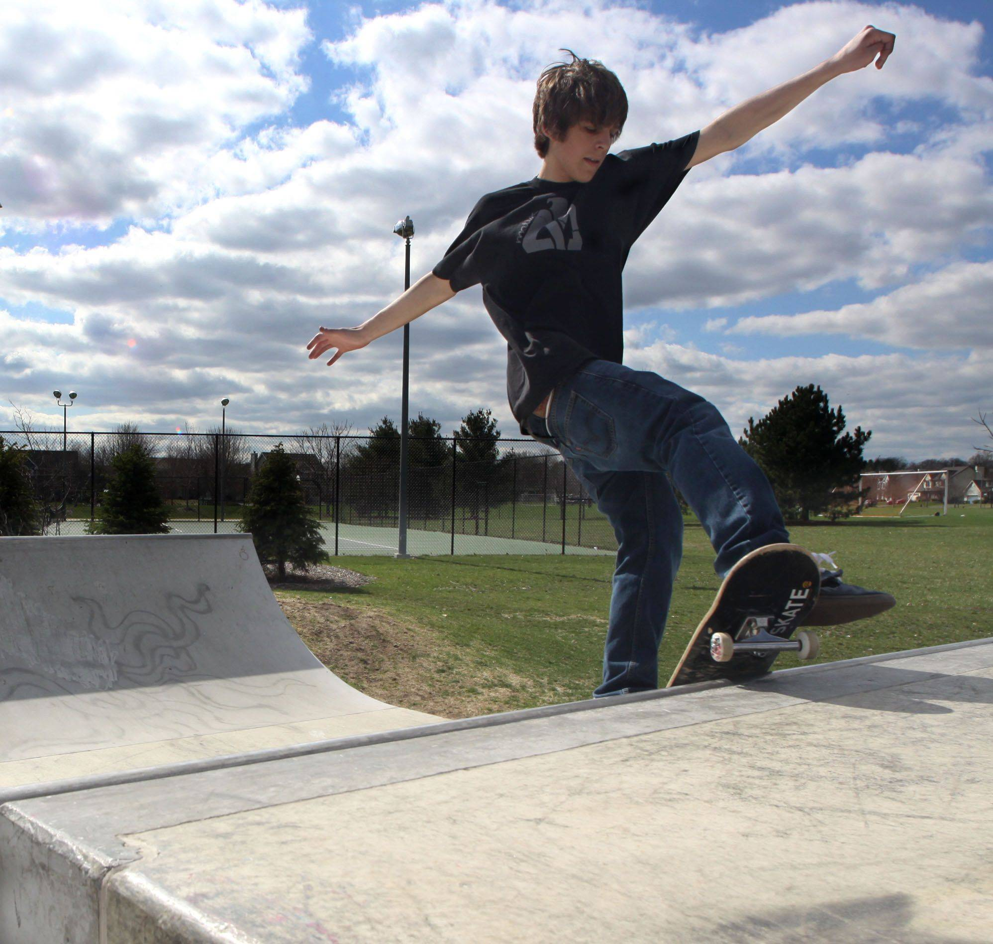 Logan Burton, 15, of Algonquin performs on the half pipe Monday at the skate area of Huffman Park in West Dundee. The Dundee Township Park District is trying to decide how to combat graffiti and litter at the park.