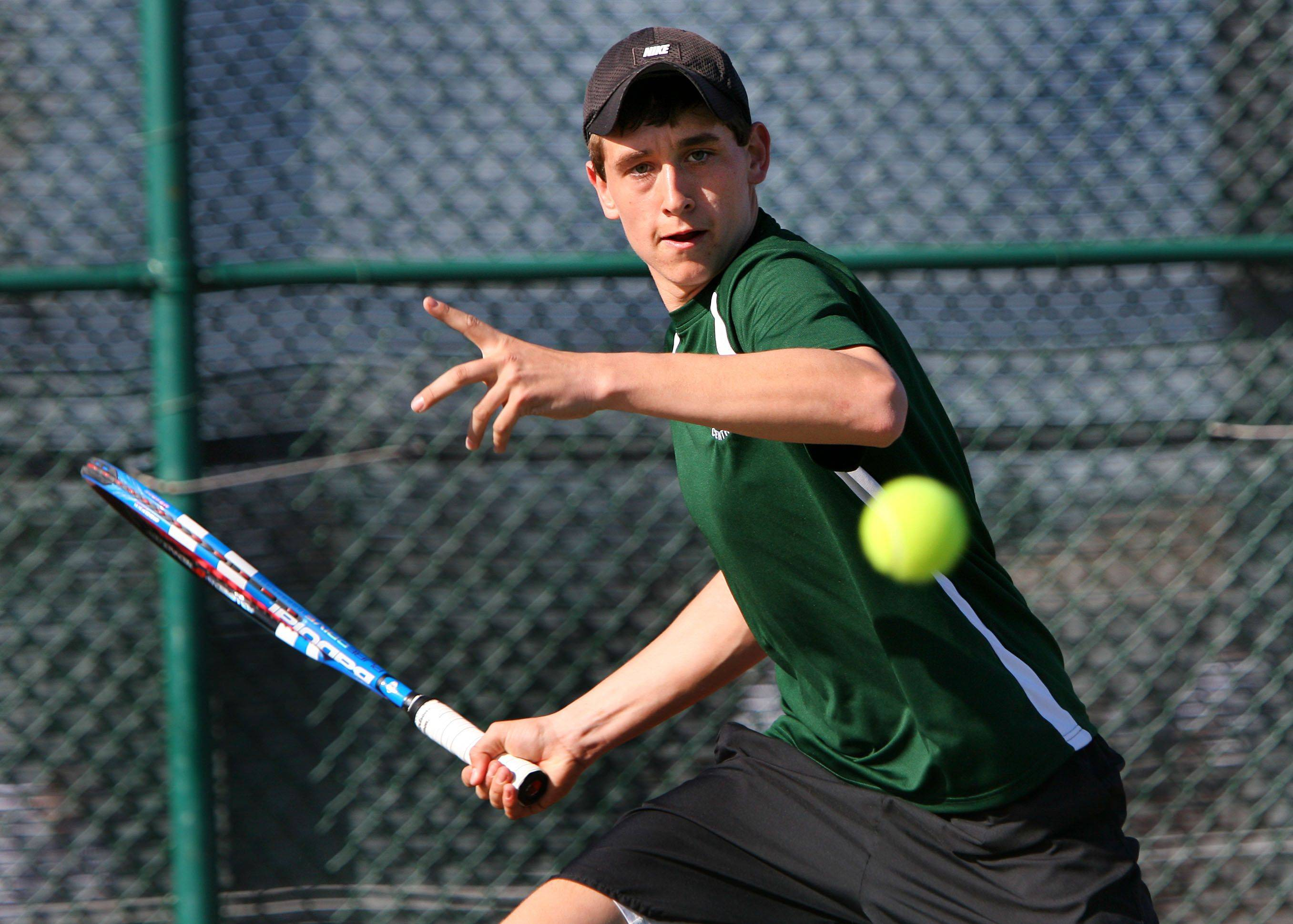 No. 1 singles player Mitch Granger hits a forehand during his match against Crystal Lake Central Tuesday at Grayslake Central High School.