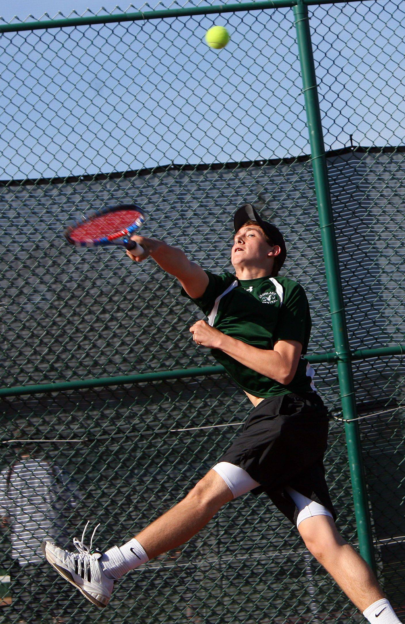 No. 1 singles player Mitch Granger hits a baseline shot during his match against Crystal Lake Central Tuesday at Grayslake Central High School.