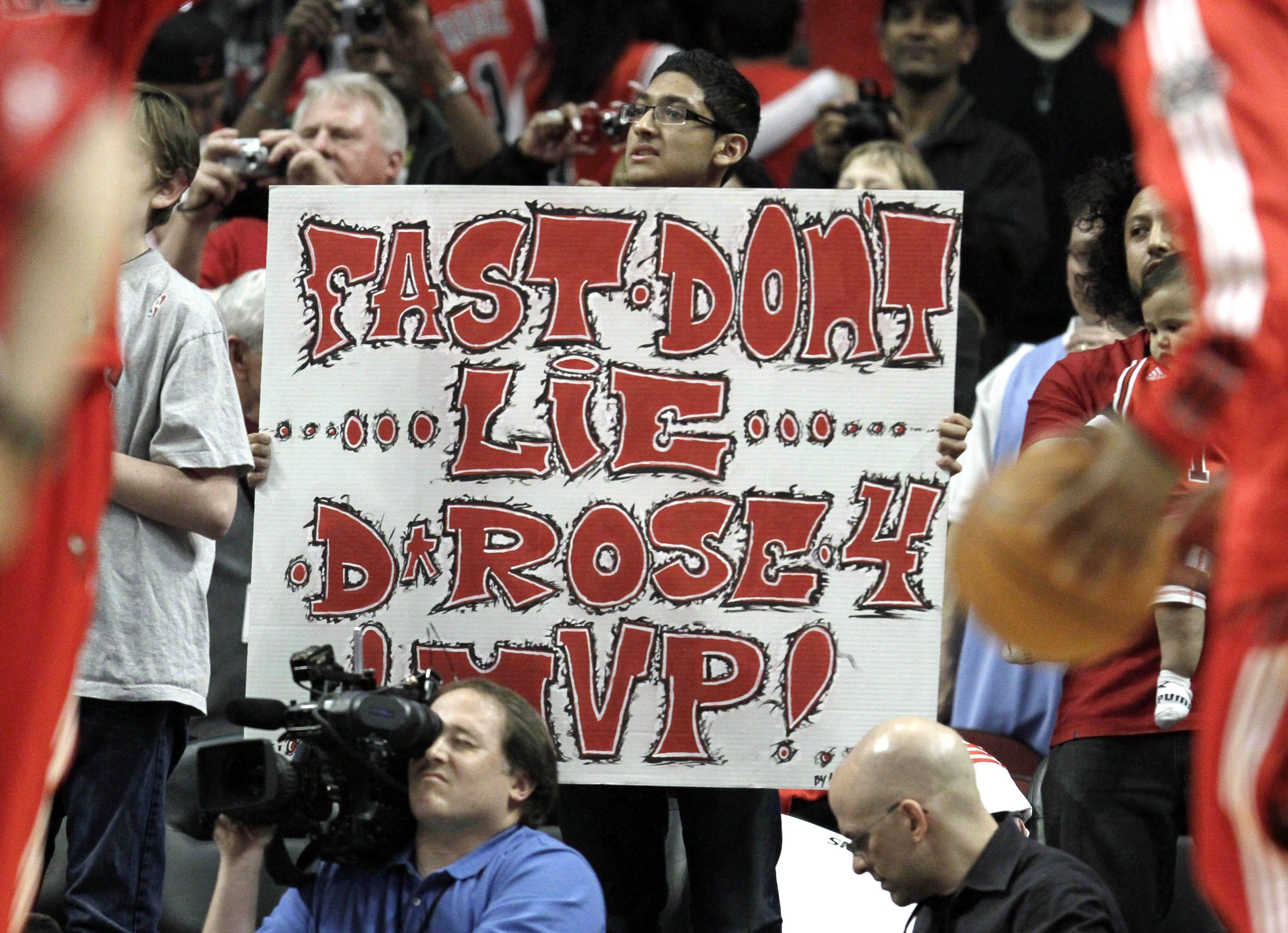 A Bulls fan holds a sign before the game against the New Jersey Nets in Chicago Wednesday.