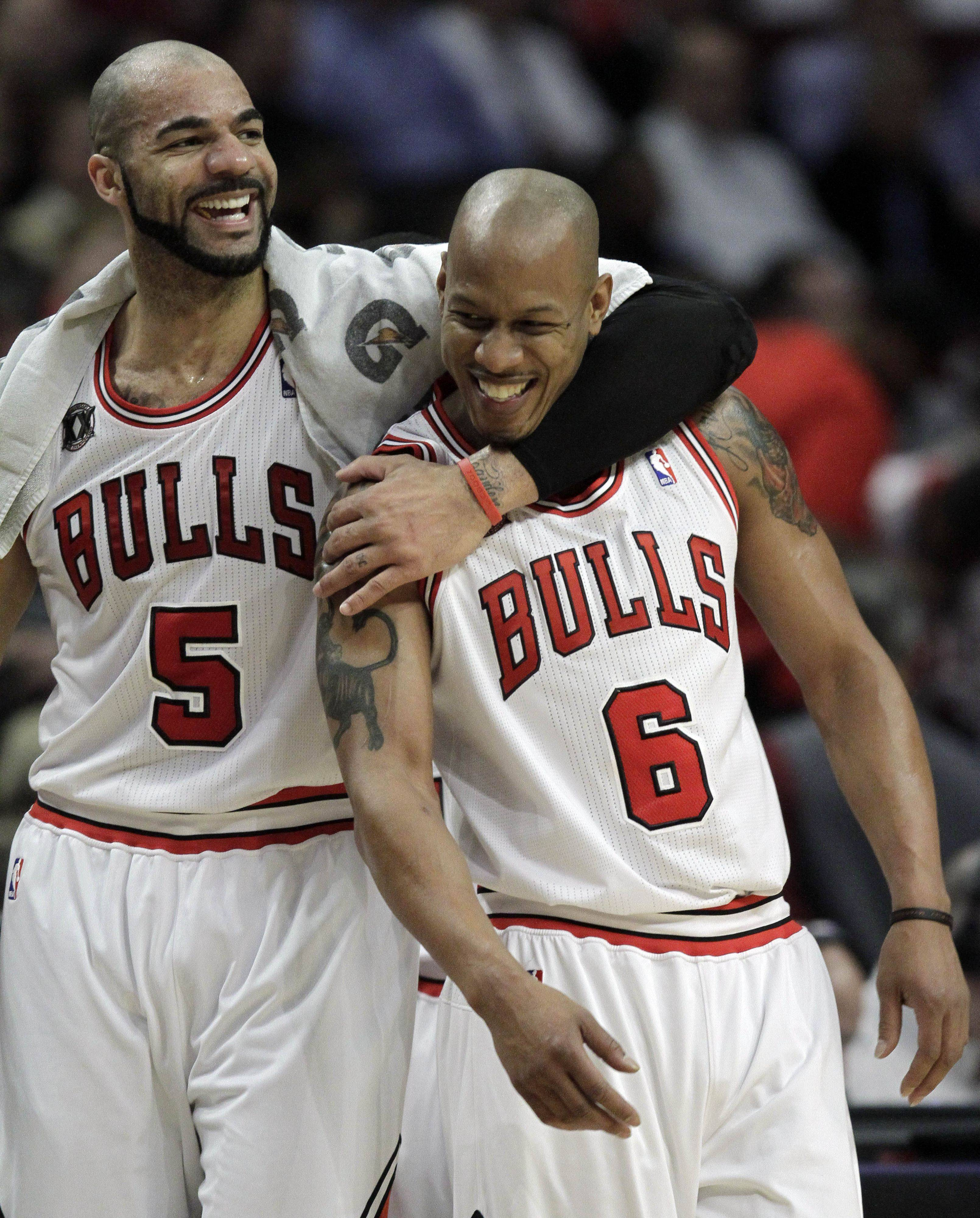 Carlos Boozer, left, and Keith Bogans smile during the first quarter Wednesday in Chicago.
