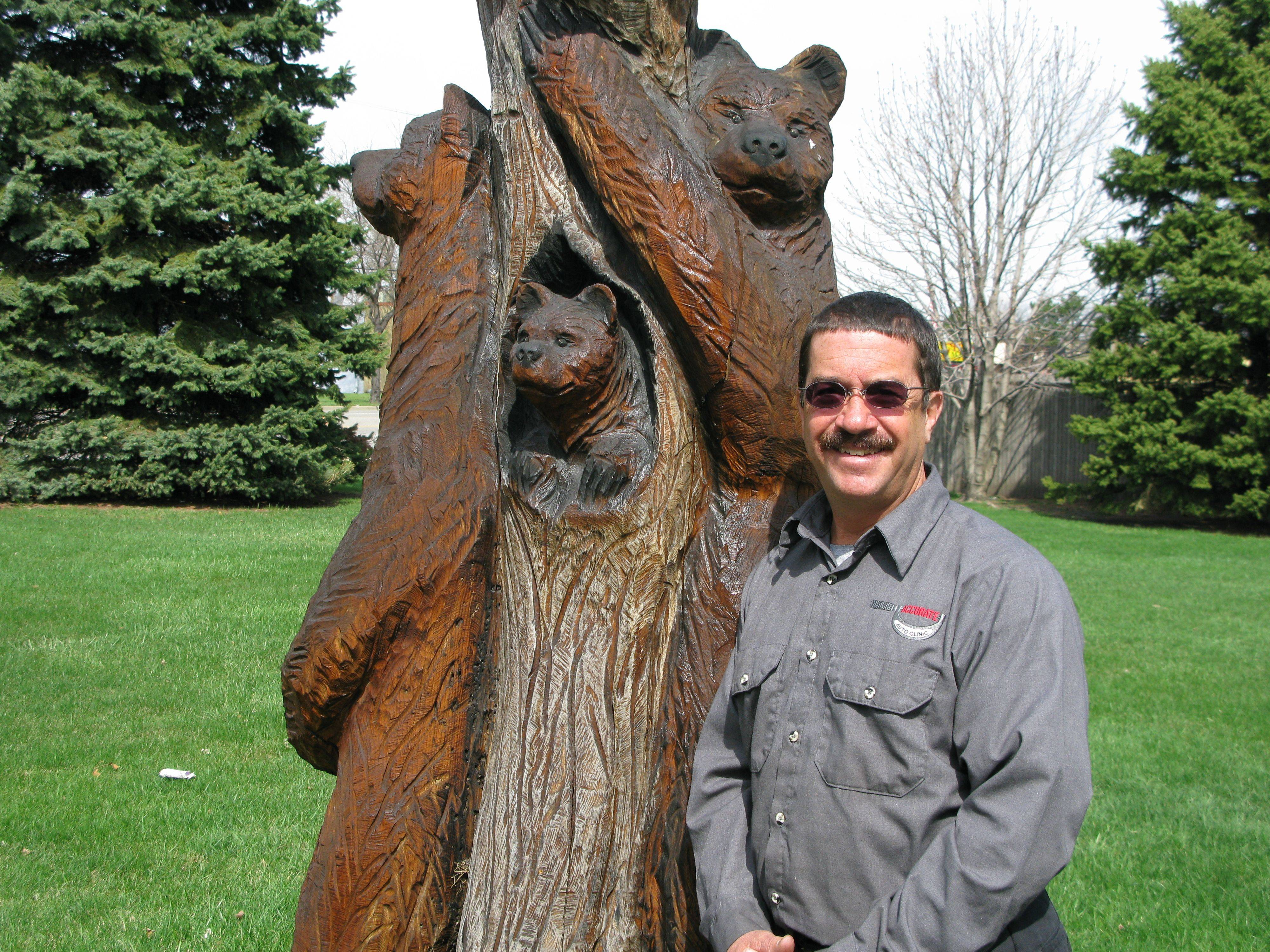Des Plaines' new 8th Ward alderman-elect Mike Charewicz stands next to a tree in his yard depicting his family. Charewicz says his top priorities are flooding, maximizing casino revenues and bringing in new businesses.