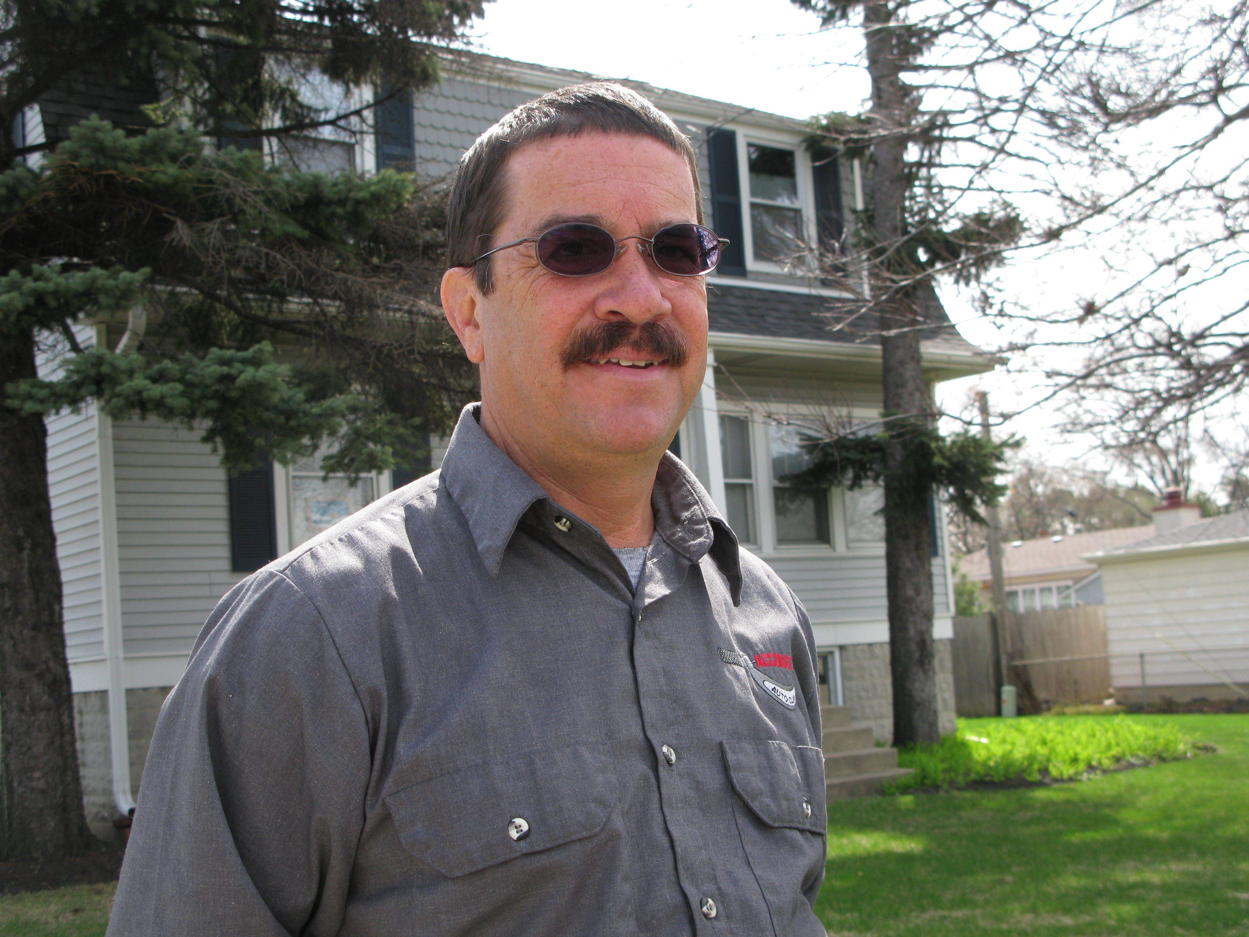 Des Plaines' new 8th Ward alderman-elect Mike Charewicz, standing in front of his home, says his top priorities are flooding, maximizing casino revenues and bringing in new businesses.