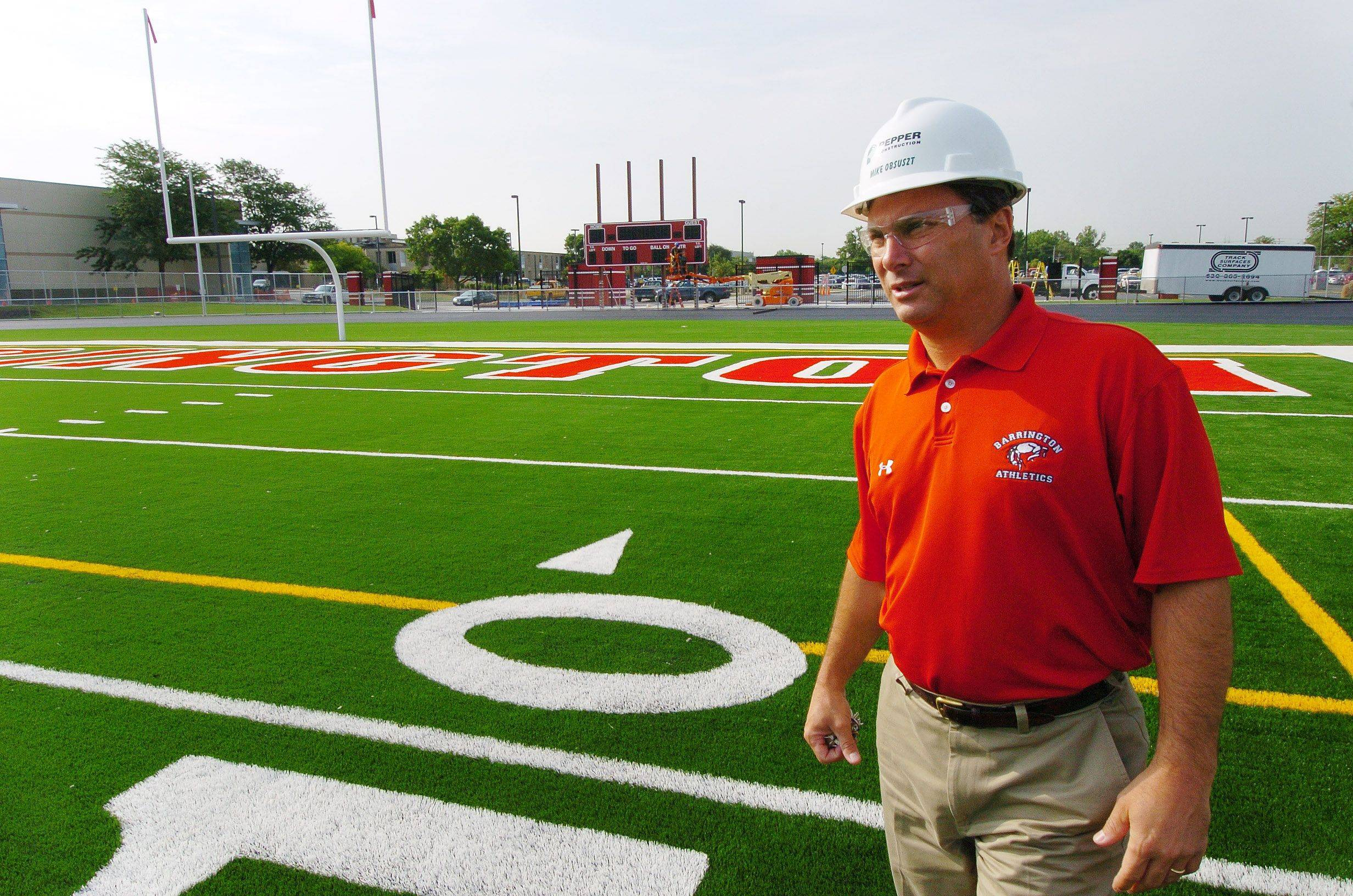 Barrington High School Athletic Director Mike Obsuszt walks the newly artificial surface at the school's football stadium in 2008. Hersey and Wheeling high schools will join Barrington High later this year in having an artificial football field.