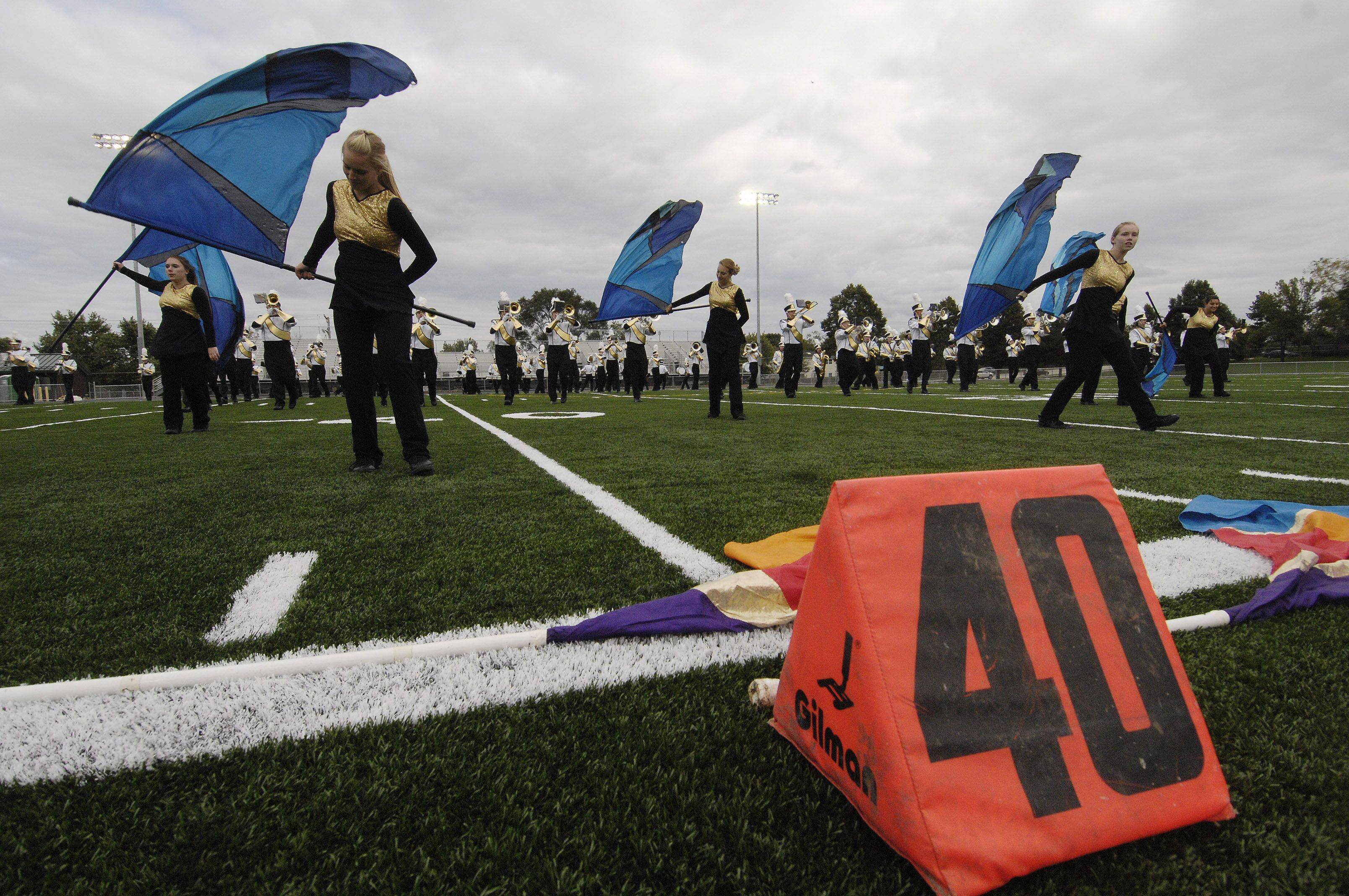 Fremd High School holds its first student activity -- a dedication ceremony featuring the marching band, cheerleaders and many other student groups -- on the new artificial turf in the school's stadium in 2008. Hersey and Wheeling high schools will join Fremd and Barrington High School later this year as a Northwest suburban high school with an artificial football field.