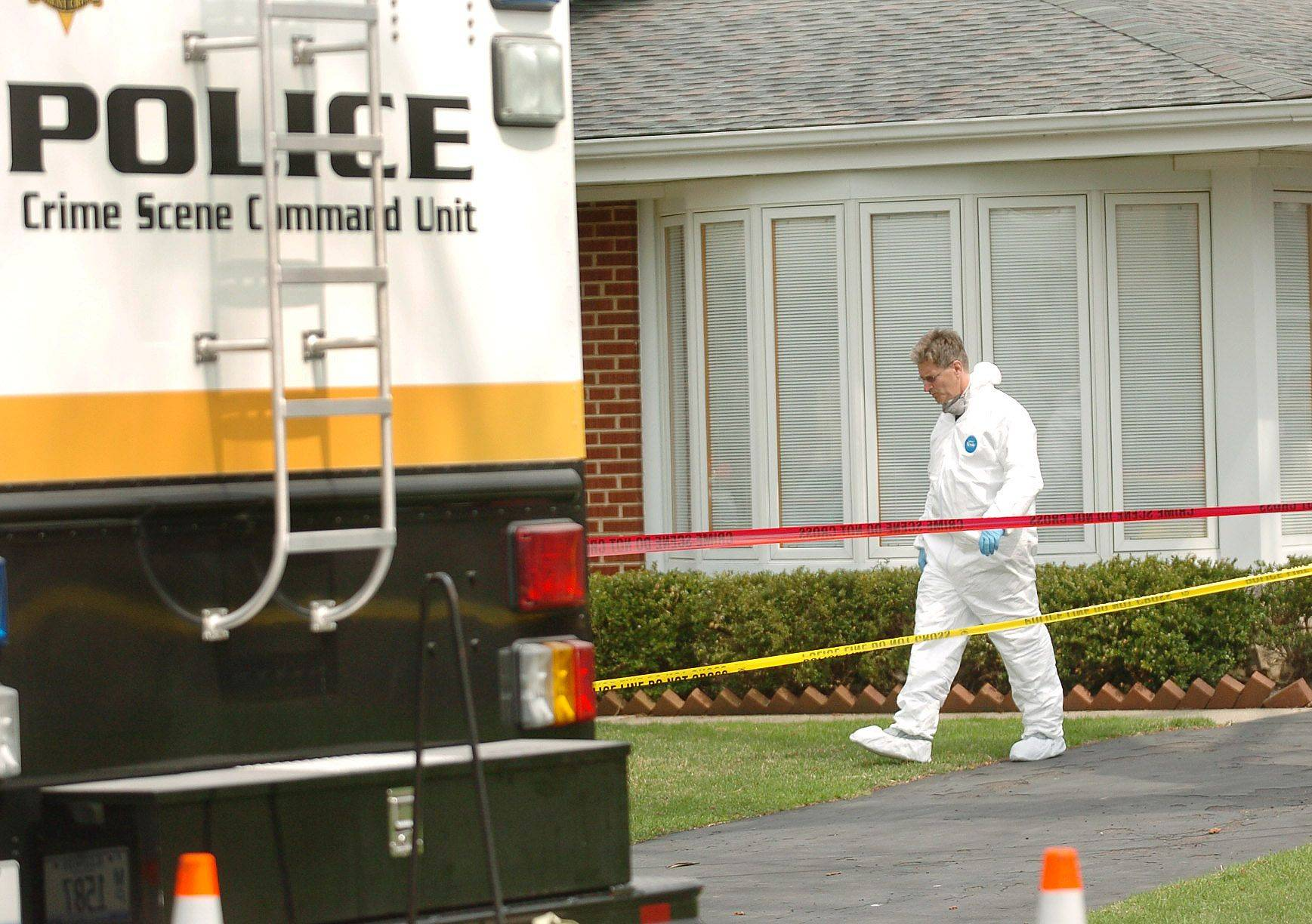 Detectives worked the scene of a death investigation Thursday in the 1000 block of Wilshire Lane in Arlington Heights.