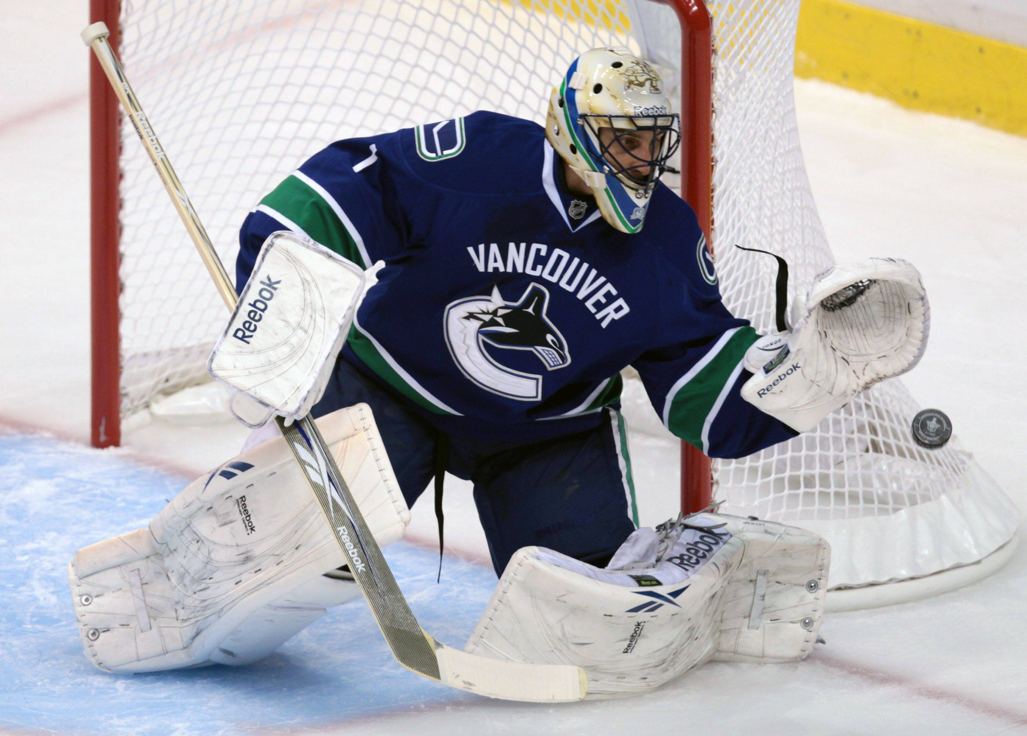 The Canucks' Roberto Luongo makes a save against the Blackhawks during the first period of Game 1 Wednesday.