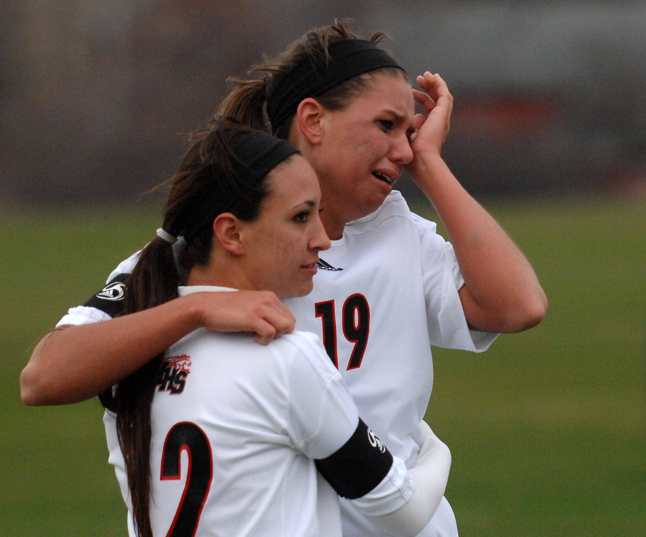 Huntley's Sam Zobott (19) is consoled by teammate Be Burry after their shootout loss to Glenbrook South during Thursday's quarterfinal of the Pepsi Showdown in Huntley. Zobott's missed kick in the shootout provided the final margin as Glenbrook South outscored them 5-3.