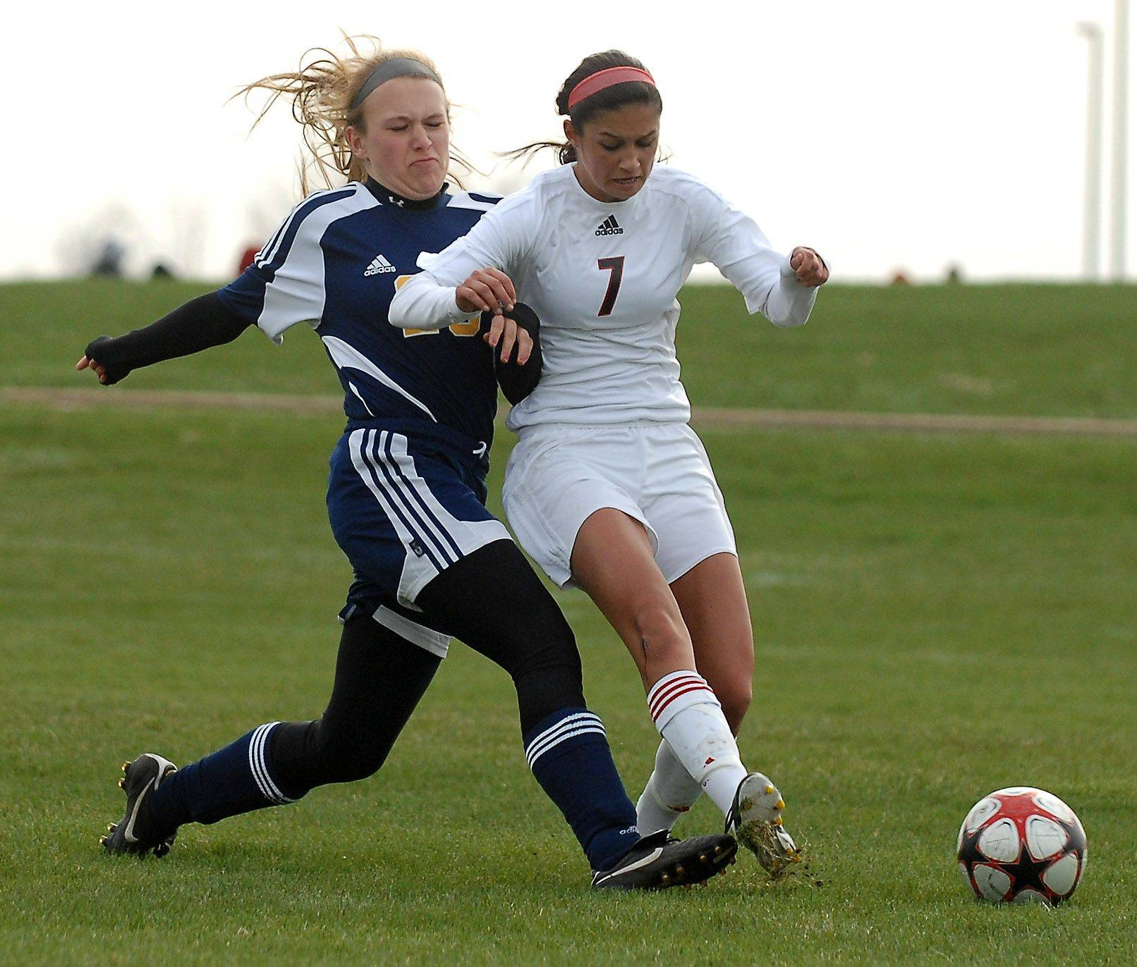 Huntley's Delaney Loprieno and Glenbrook South's Lauren Sroubek battle for the ball during Thursday's quarterfinal of the Pepsi Showdown in Huntley.