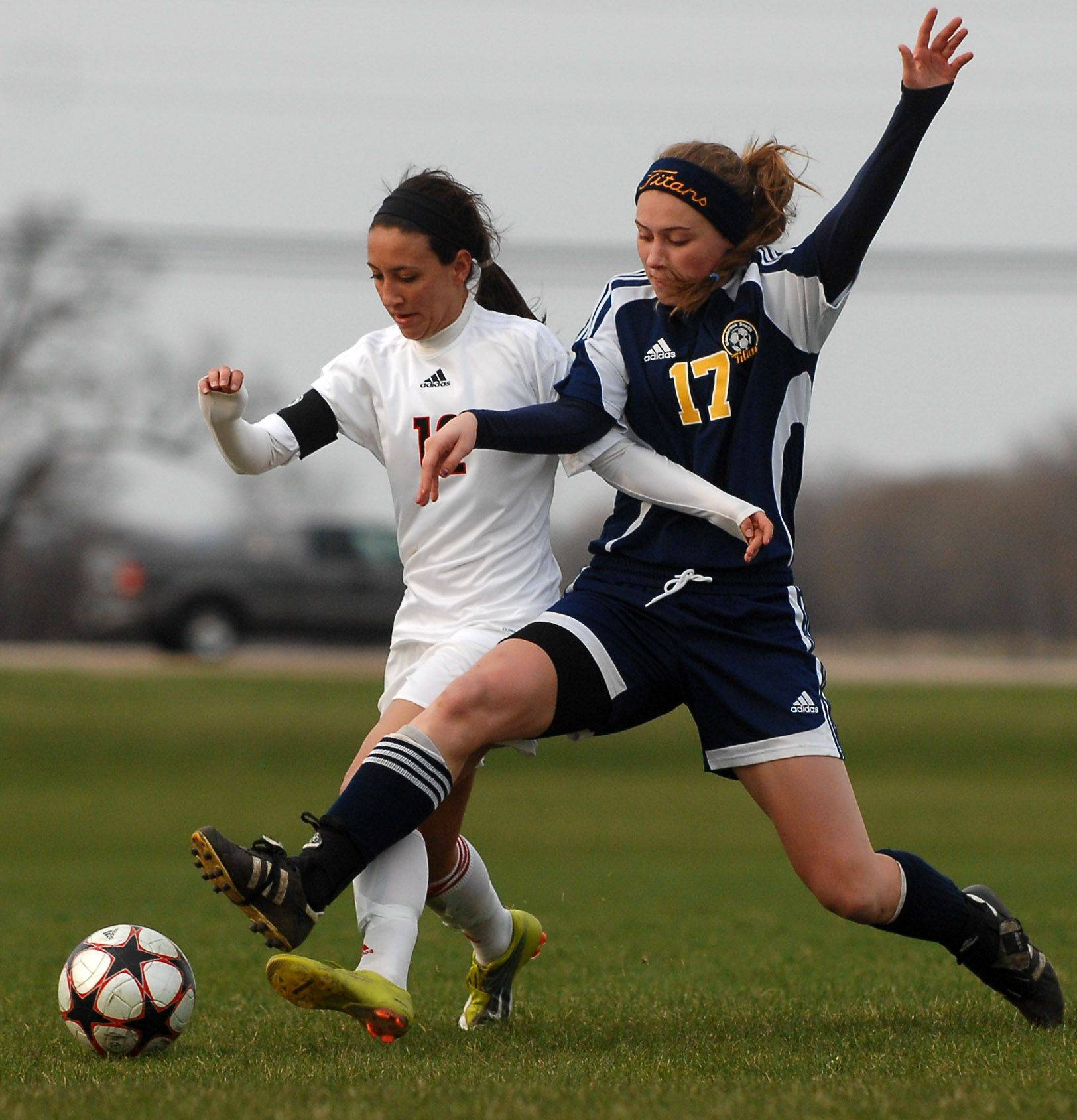 Huntley's Be Burry and Glenbrook South's Sara Meinecke battle for the ball during Thursday's quarterfinal of the Pepsi Showdown in Huntley.