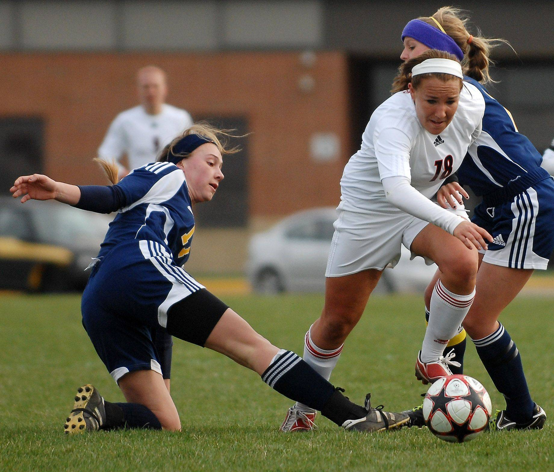 Huntley's Aimee Wronski battles through a pair of Glenbrook South defenders during Thursday's quarterfinal of the Pepsi Showdown in Huntley.
