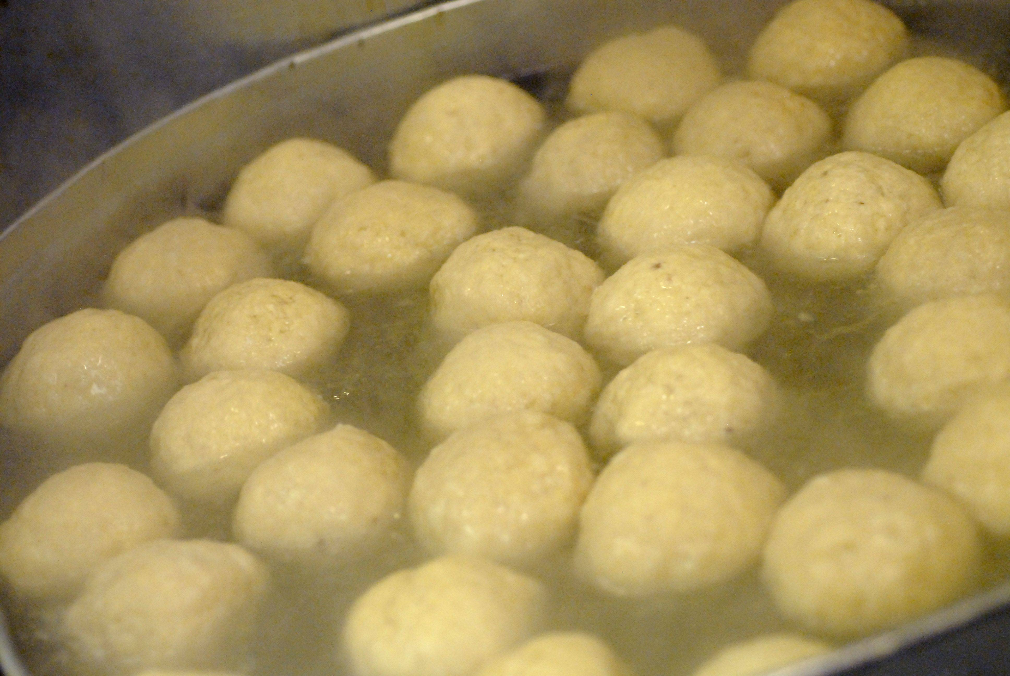 Beginning their bath in boiling water, these matzo balls will be among the nearly 3,000 prepared for the Passover Seder at The Continental Restaurant in Buffalo Grove.