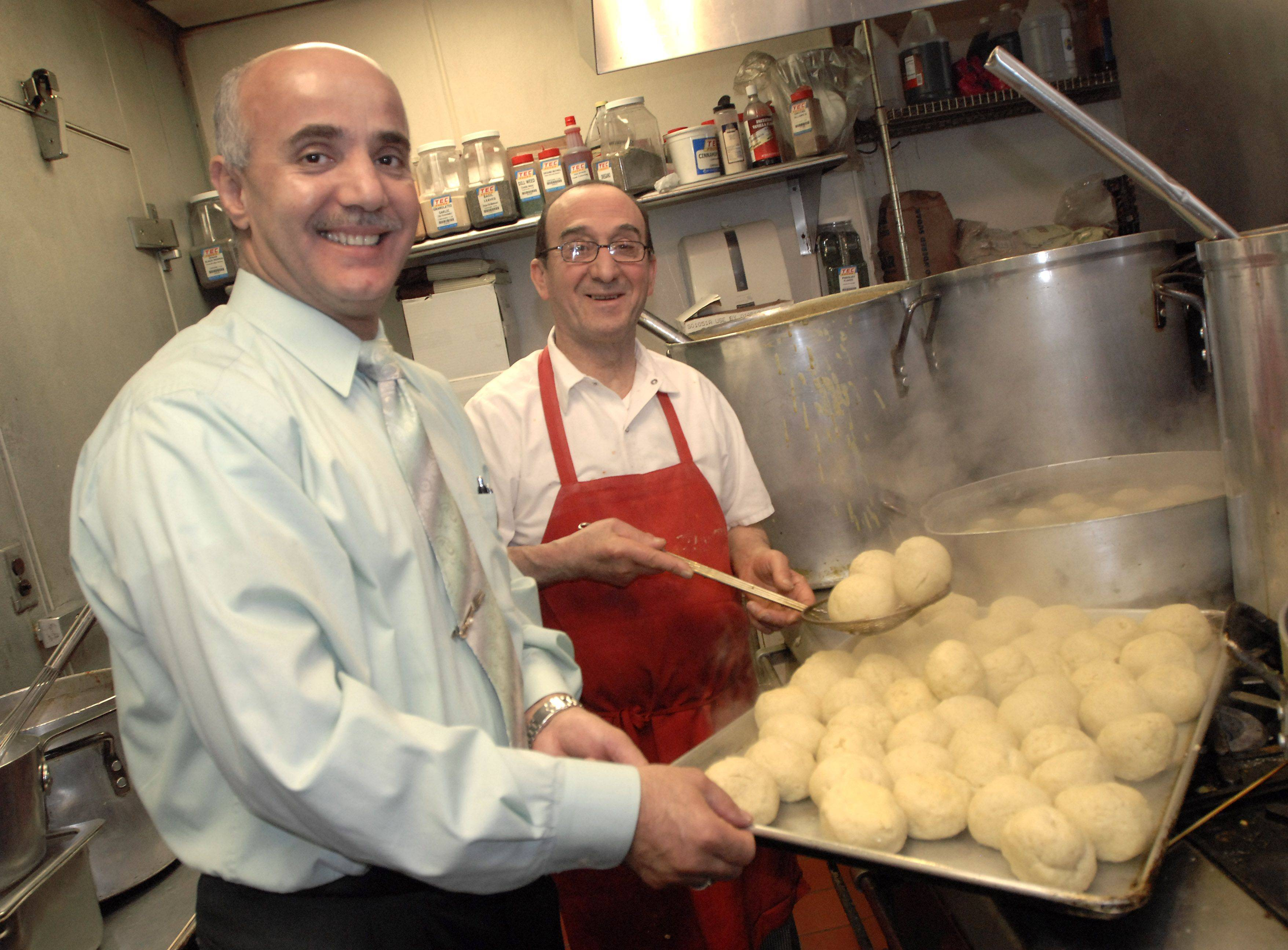 Pete Panayiotou, left, and his chef George Kokkines take fluffy matzo balls from their boiling water bath at The Continental Restaurant in Buffalo Grove. Started 15 years ago as a favor to a loyal customer, Panayiotou, a Greek Orthodox Christian, and his restaurant annually serve traditional Jewish Passover meals to sold-out crowds.