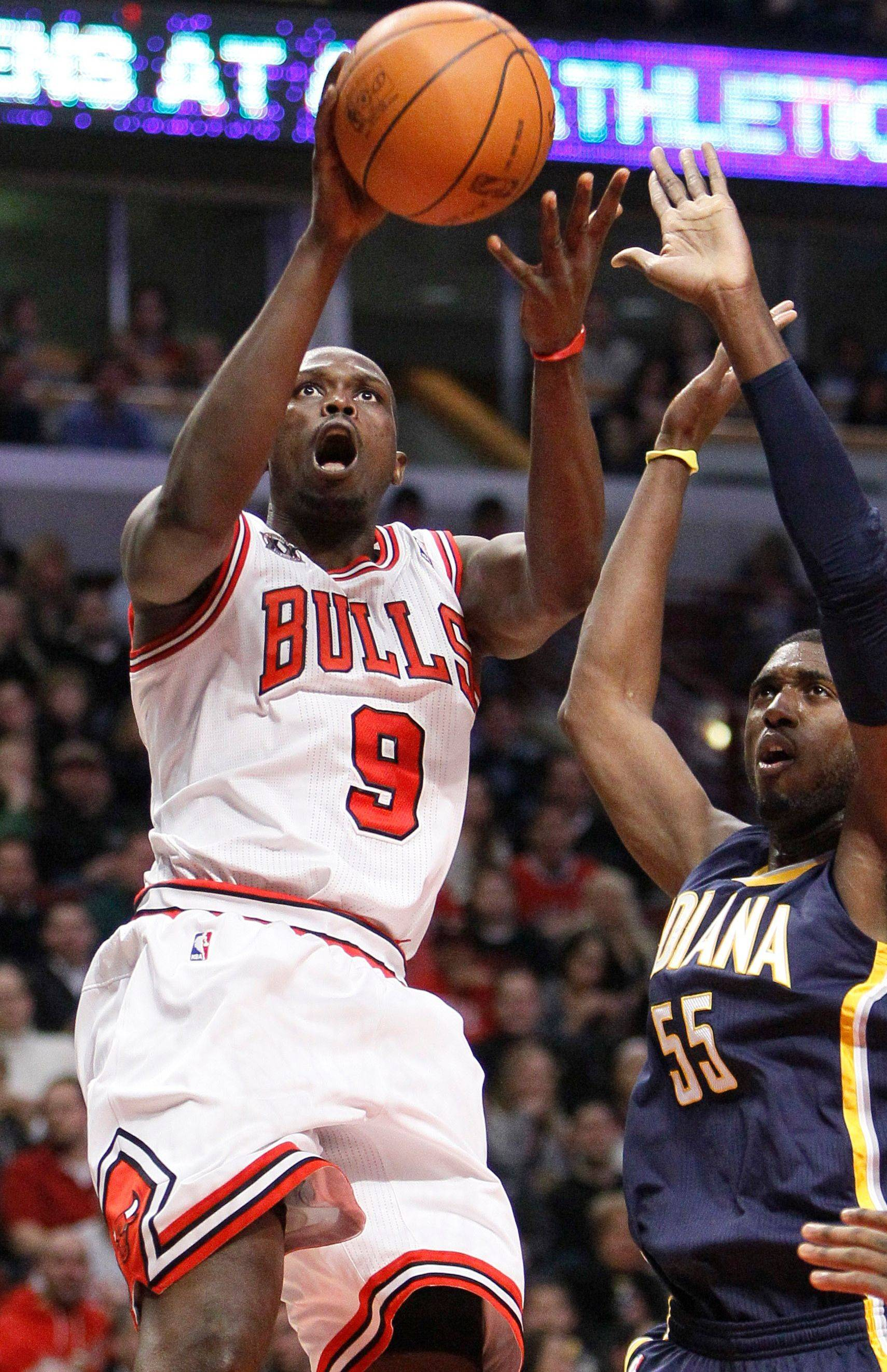 Chicago Bulls small forward Luol Deng, left, drives to the basket past Indiana Pacers center Roy Hibbert during the second half of an NBA basketball game Monday, Dec. 13, 2010, in Chicago. The Bulls won 92-73.