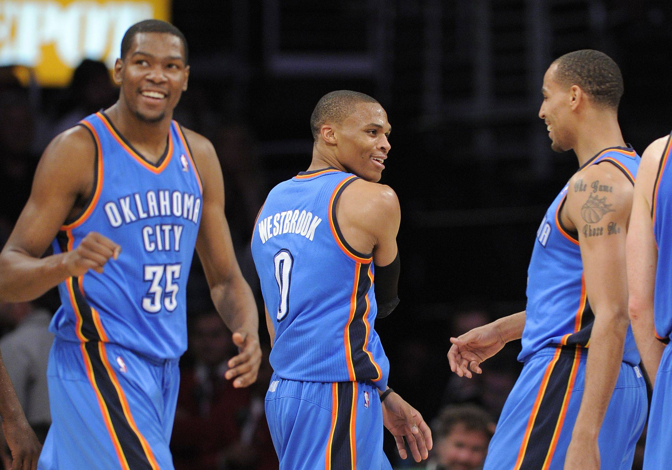Oklahoma City Thunder forward Kevin Durant, guard Russell Westbrook, center, and guard Thabo Sefolosha of Switzerland celebrate during an April 120-106 win over Los Angeles.