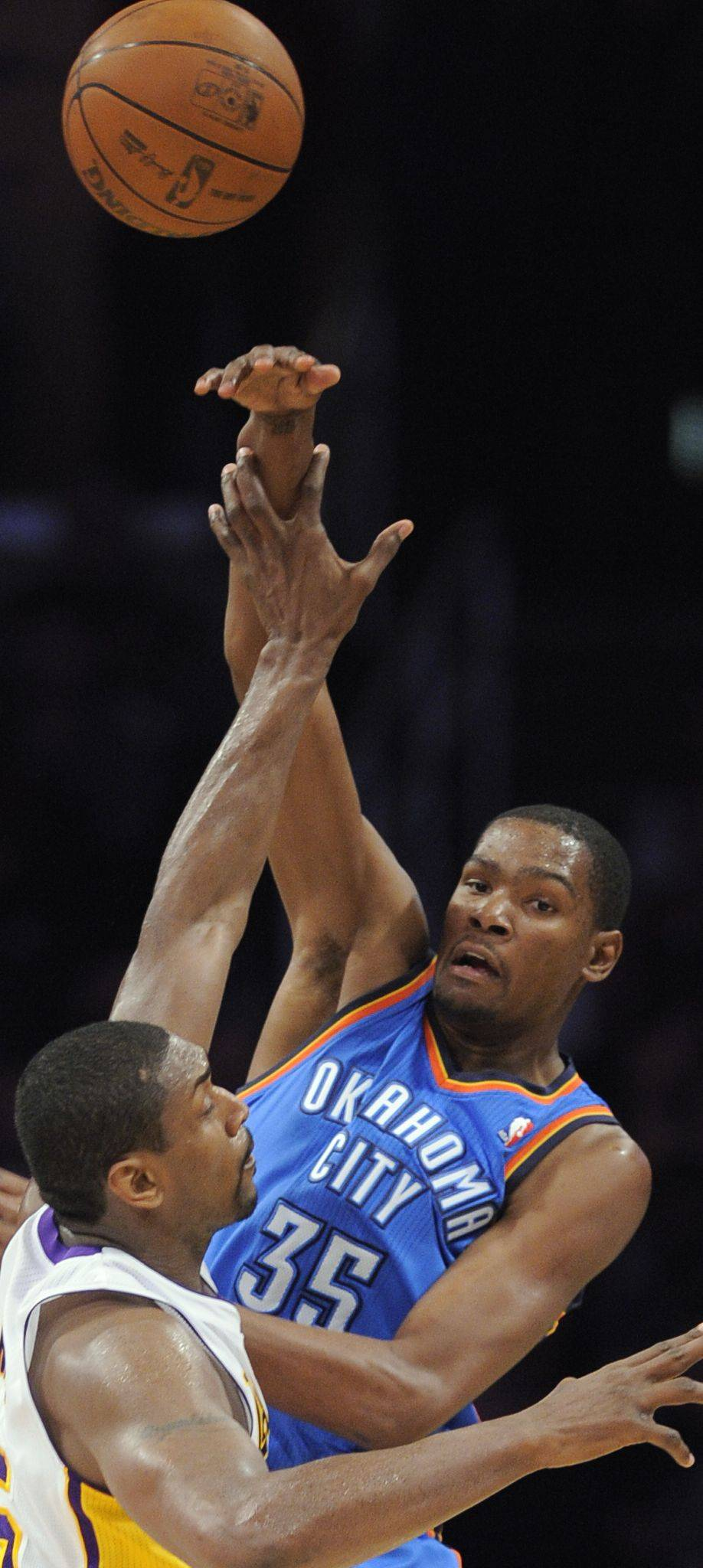 Oklahoma City Thunder forward Kevin Durant, top, passes over Los Angeles Lakers forward Ron Artest in an April game in Los Angeles. The Thunder won 120-106.