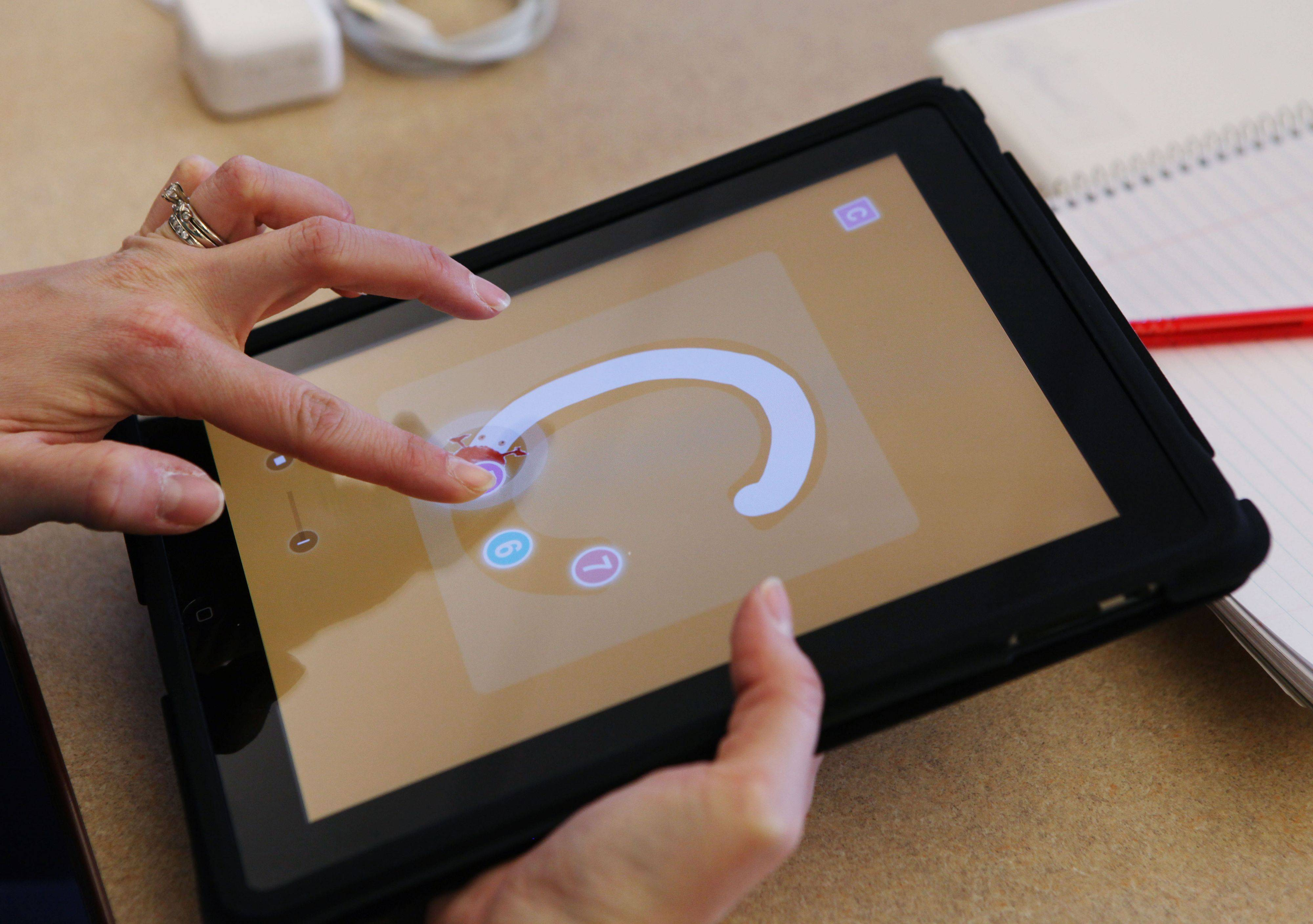 Kindergarten teacher Amy Heimerl tries out a program for learning letters on an iPads in Auburn, Maine. Five kindergarten teachers were given iPads to try out in preparation for next year when nearly 300 kindergartners will be given their own iPad2s.