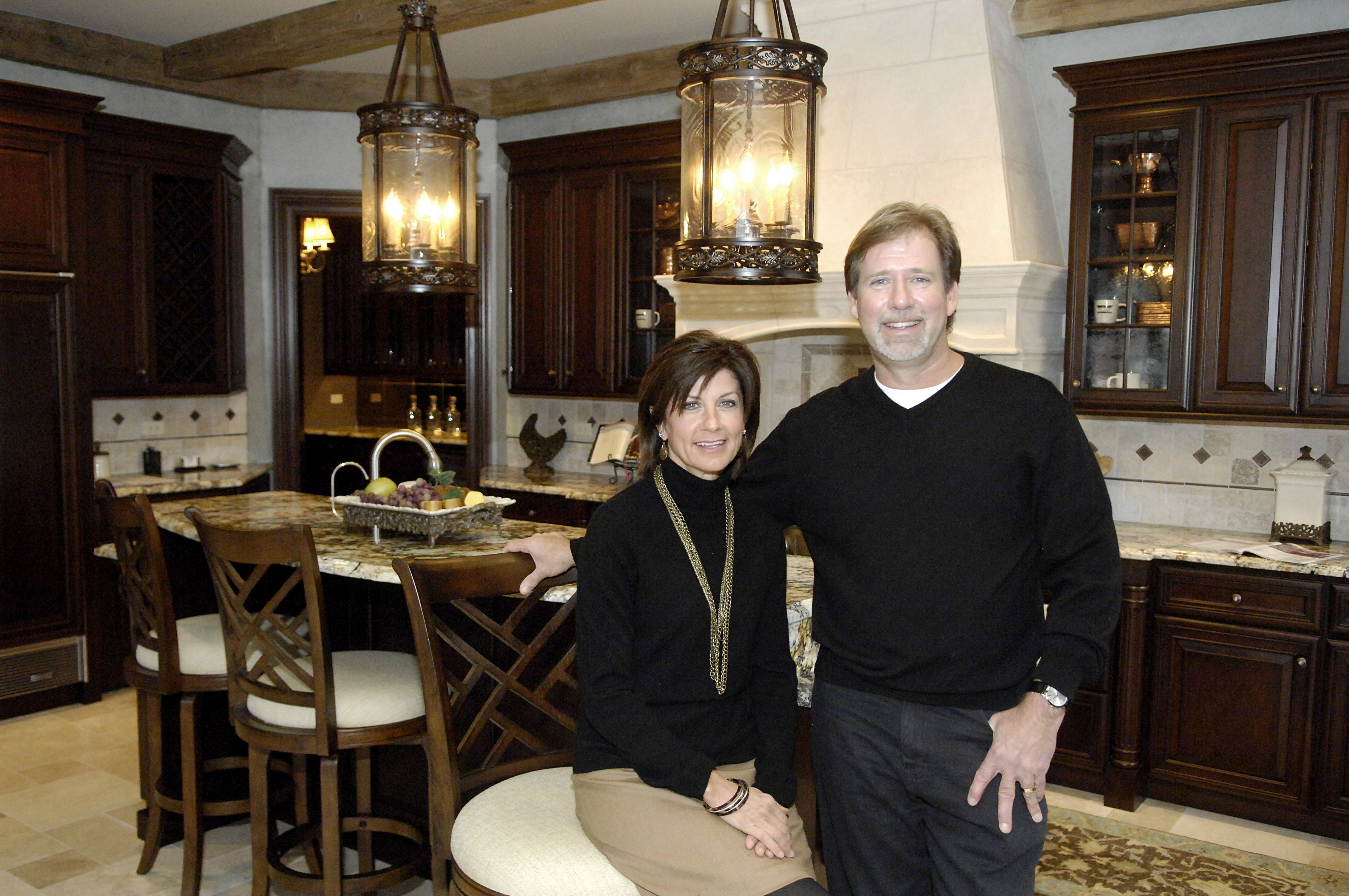 George and Lynn Havlicek of Havlicek Builders in the kitchen of a model at Innisfree in St. Charles. Lynn does the interior design of the homes.